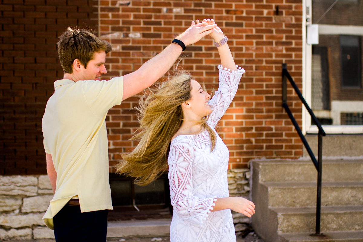 Engagment photos in Kansas City west bottoms couple dancing engagement photography