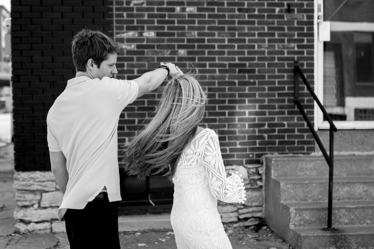 Engagment photos in Kansas City west bottoms couple dancing black and white photo engagement photography