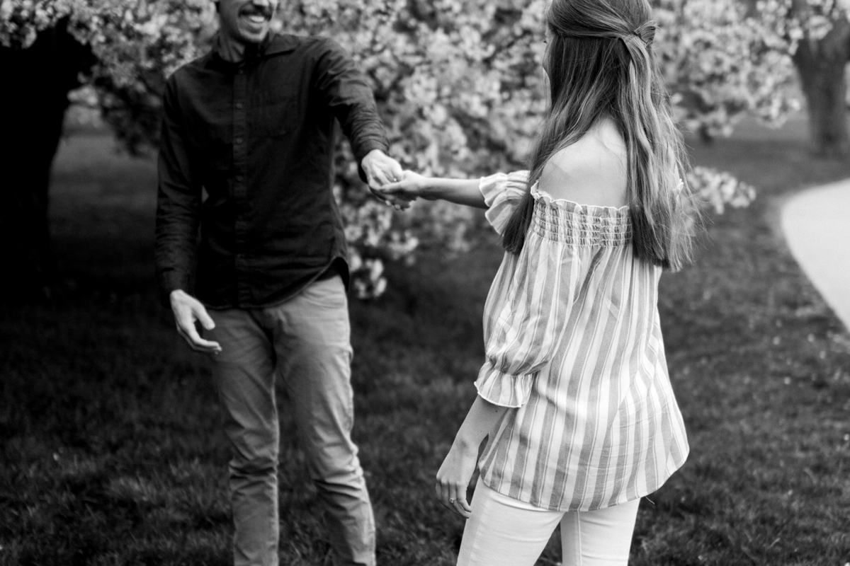 Kansas City Loose Park spring maternity session dancing by the flowering apple tree black and white photo Kansas City maternity photographer