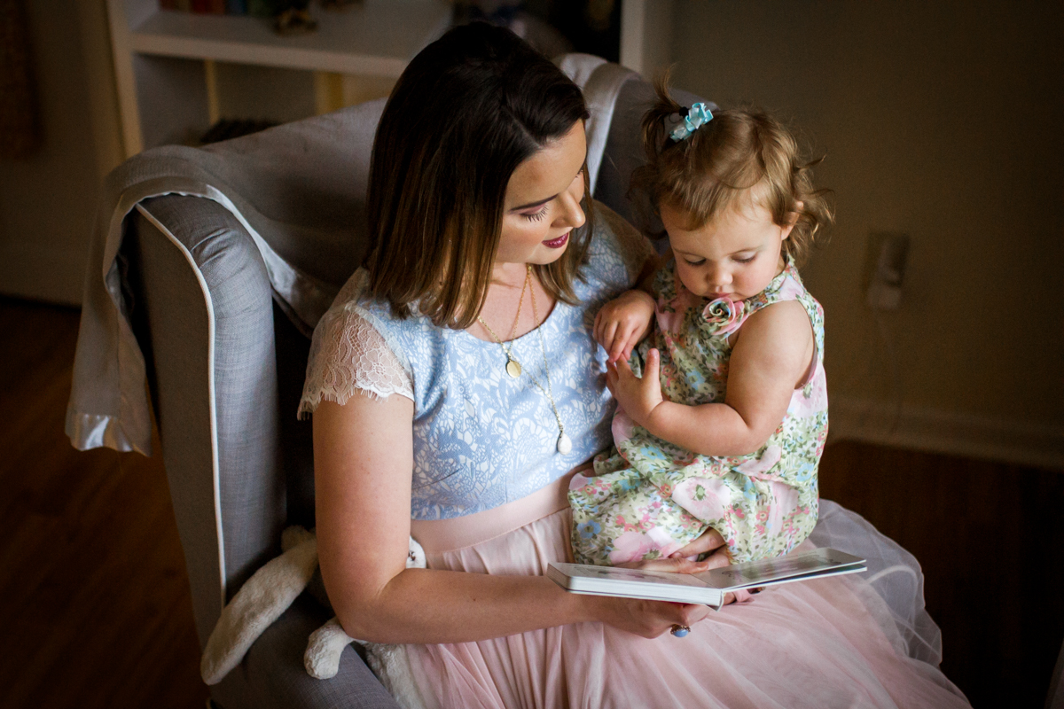 Kansas City Family photographer, in-home lifestyle family photography mother and daughter reading Rebecca Clair Photography