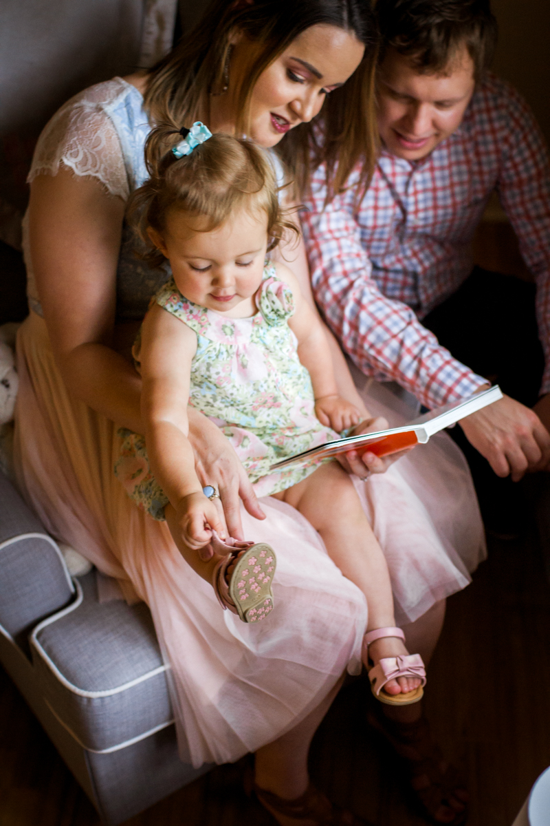 Kansas City Family photographer, in-home lifestyle family photography family reading together Rebecca Clair Photography