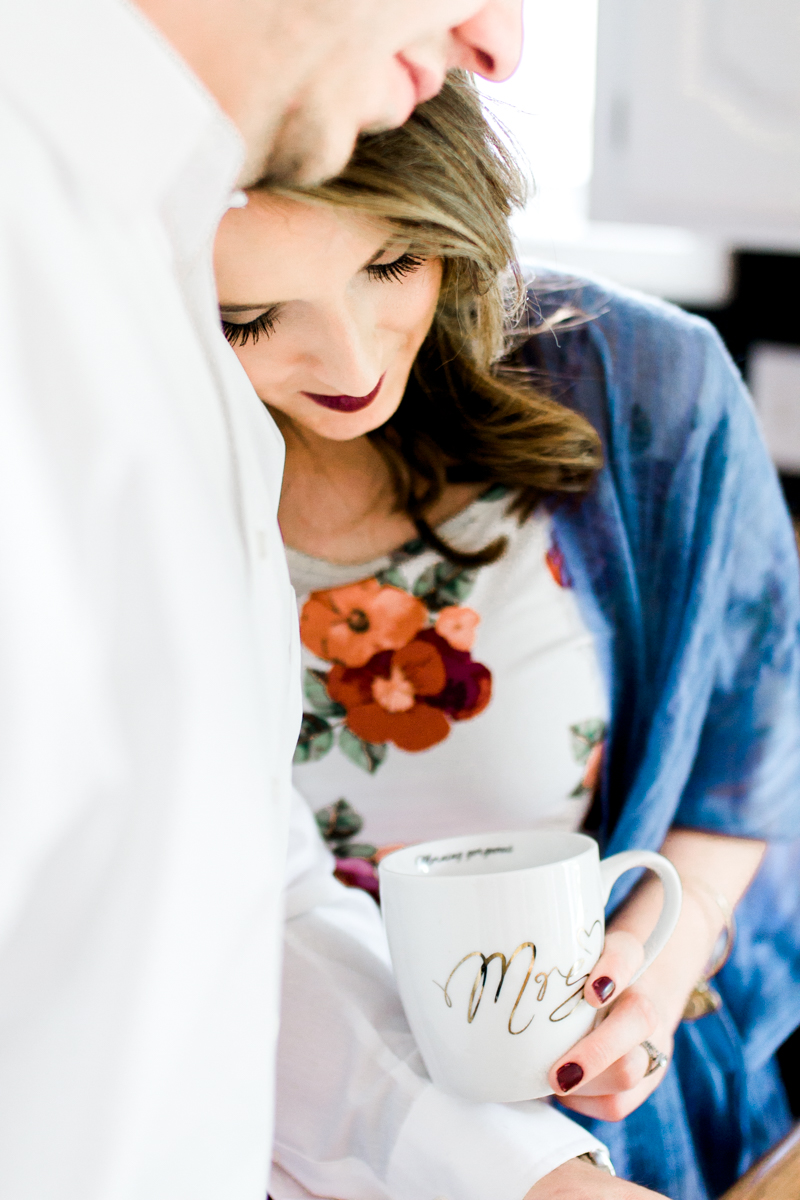 Kansas City lifestyle photographer in home couples session cuddling in the kitchen with coffee engagement photos