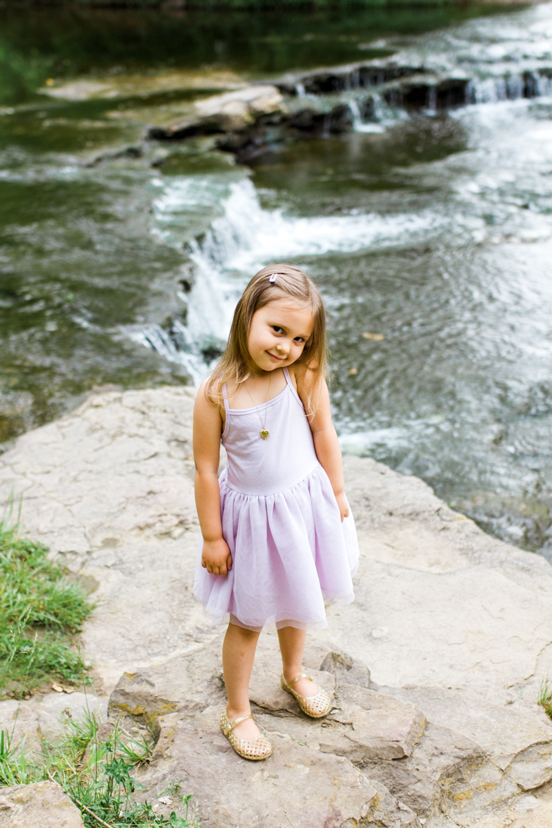 Rebecca Clair Photography Kansas City MO lifestyle family photographer Line Creek Trail Family Session little girl by a waterfall