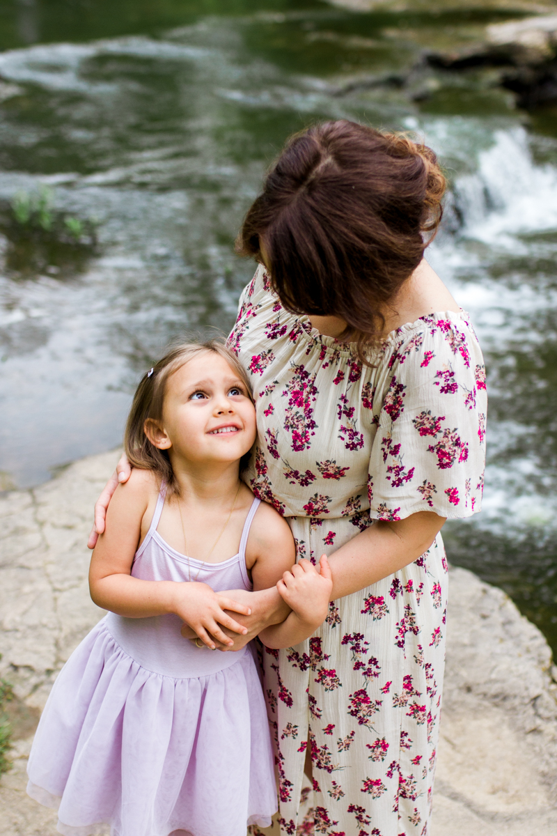 Rebecca Clair Photography Kansas City MO lifestyle family photographer Line Creek Trail Family Session daughter looking up at her mother
