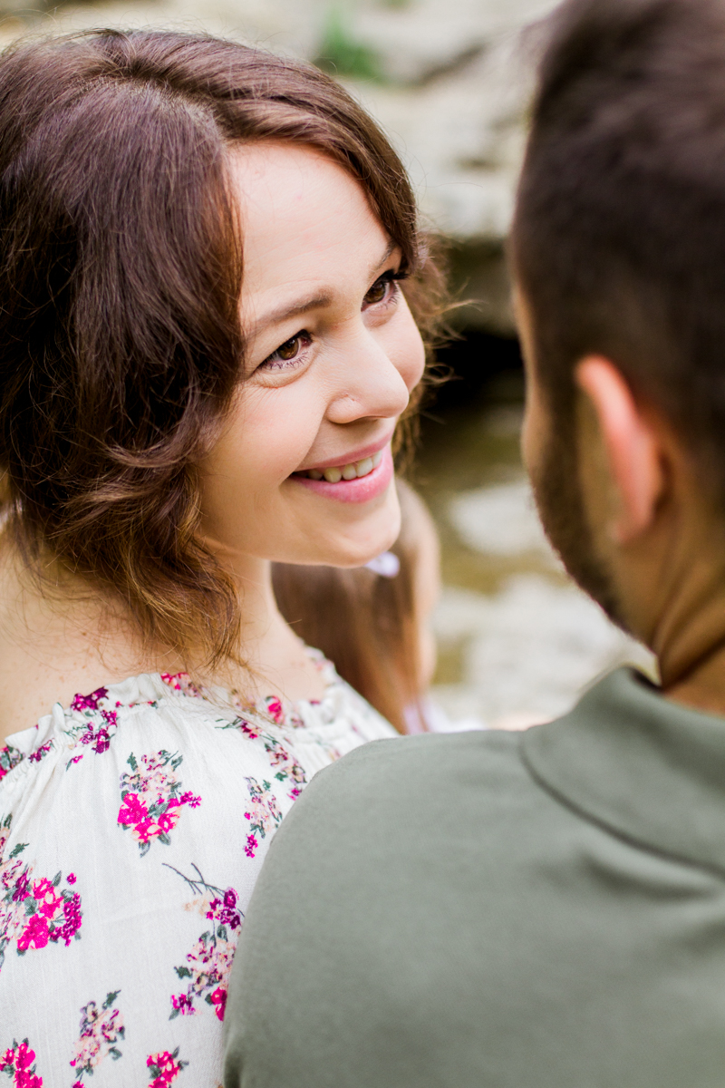 Rebecca Clair Photography Kansas City MO lifestyle family photographer Line Creek Trail Family Session wife smiling up at her husband couples photography