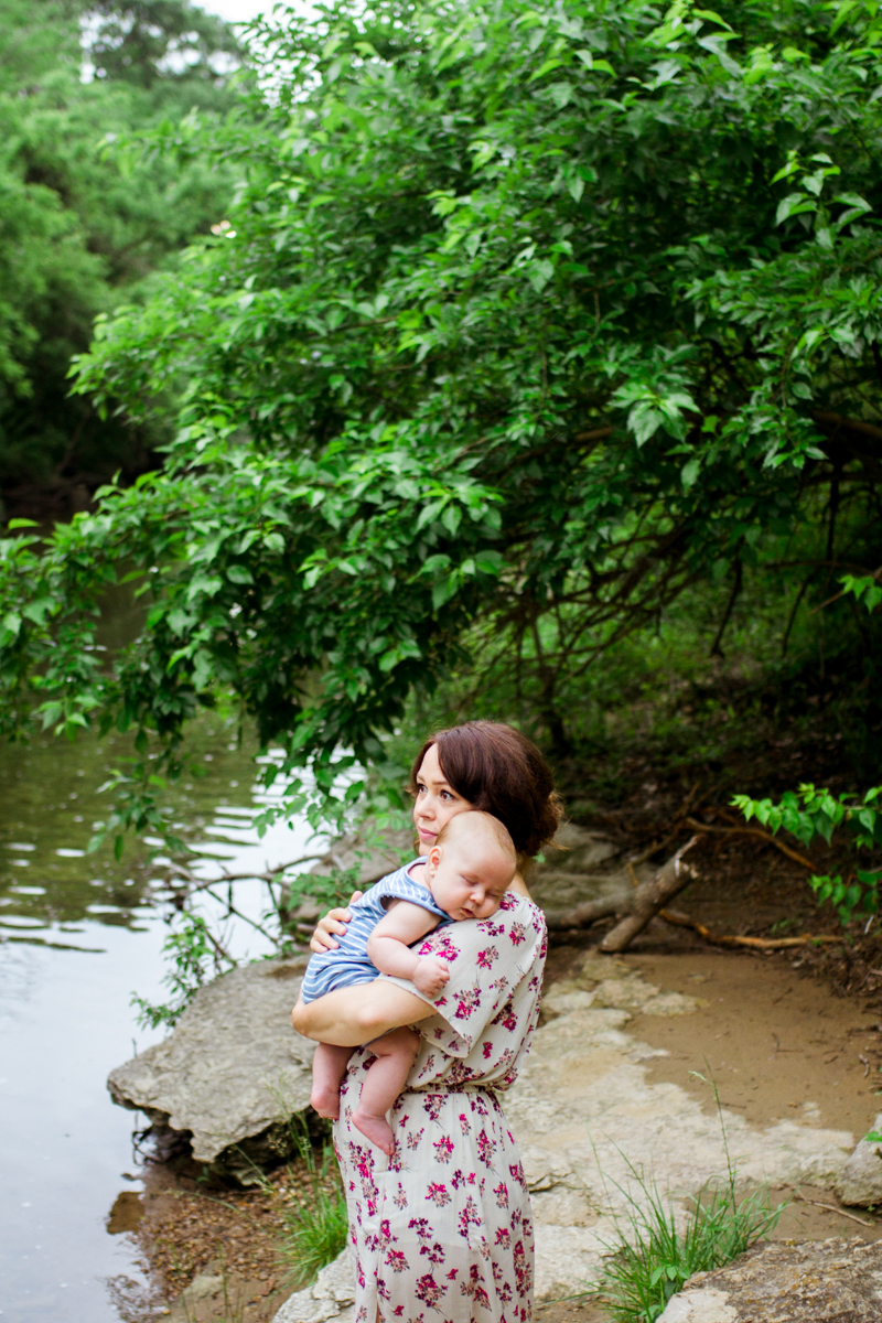 Rebecca Clair Photography Kansas City MO lifestyle family photographer Line Creek Trail Family Session mother holding baby by the creek