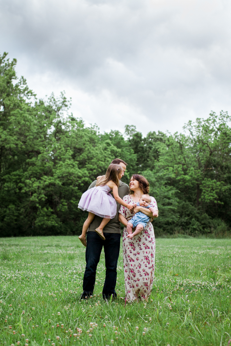 Rebecca Clair Photography Kansas City MO lifestyle family photographer Line Creek Trail Family Session family holding hands under stormy skies