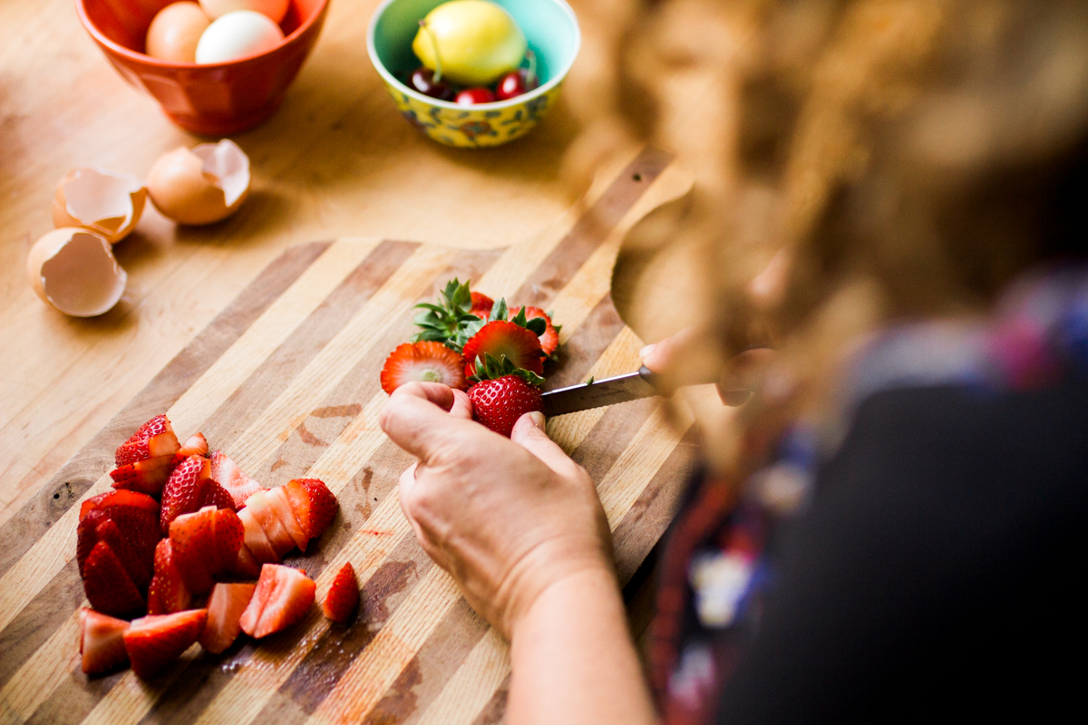 Kansas City small business lifestyle photography seven swans creperie woman slicing strawberries