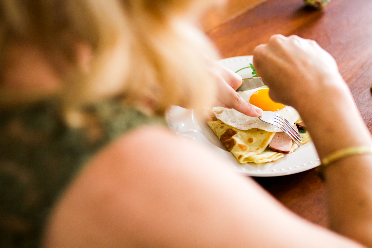 Kansas City small business lifestyle photography seven swans creperie woman eating crepe dinner party