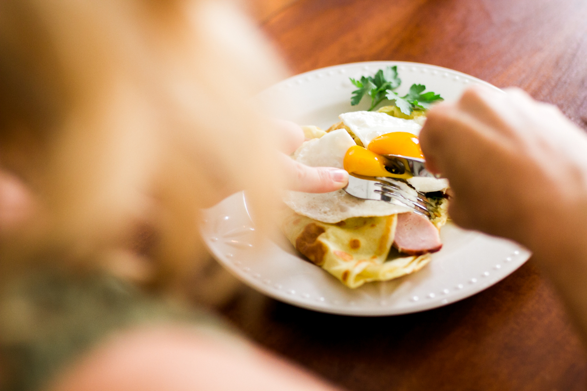 Kansas City small business lifestyle photography seven swans creperie woman eating crepe
