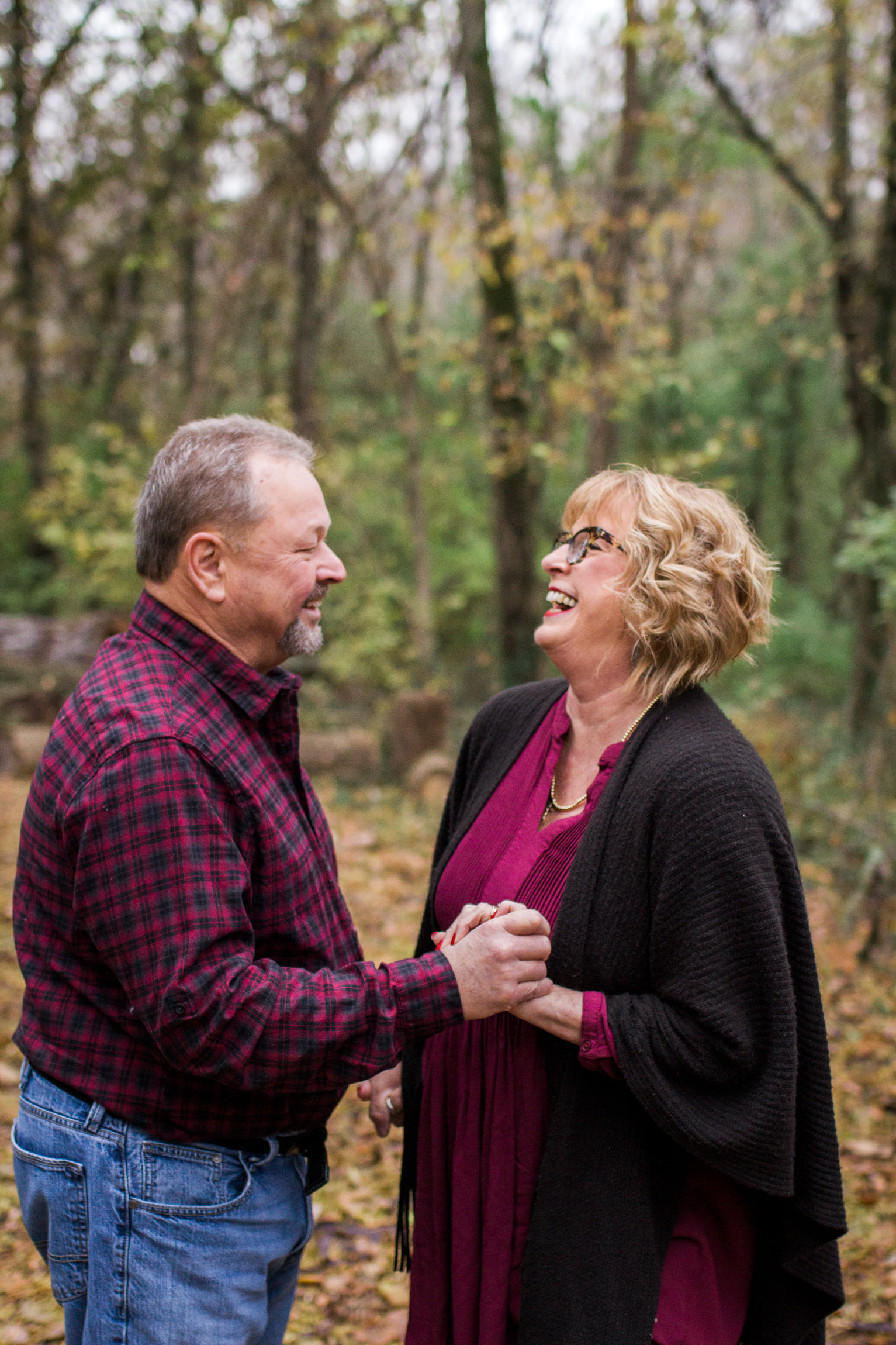 Kansas City lifestyle photographer, Kansas City family photographer, extended family session, fall family photos in the woods, older couple holding hands, grandparents portrait