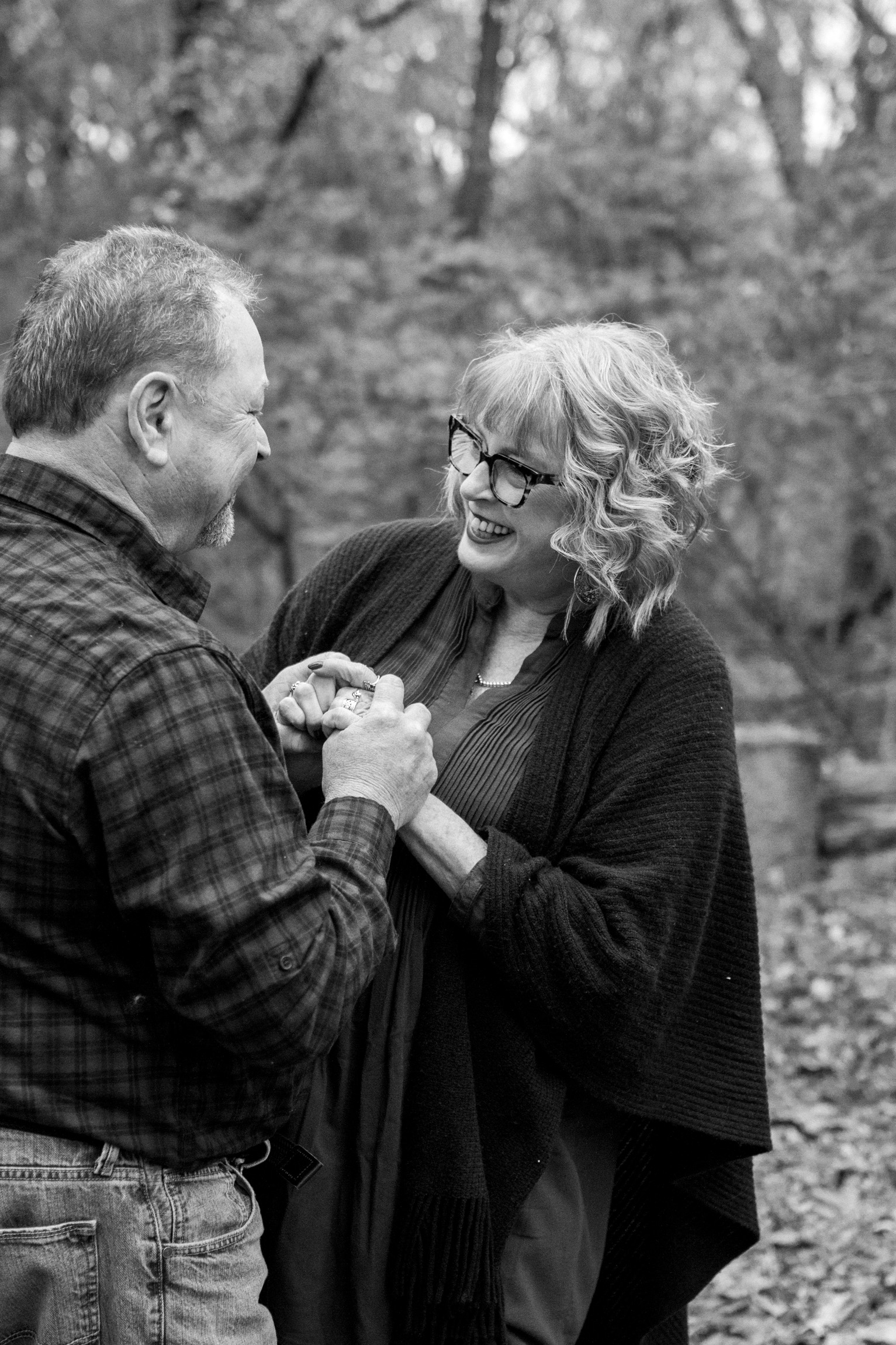 Kansas City lifestyle photographer, Kansas City family photographer, extended family session, fall family photos in the woods, older couple holding hands, grandparents portrait, black and white portrait