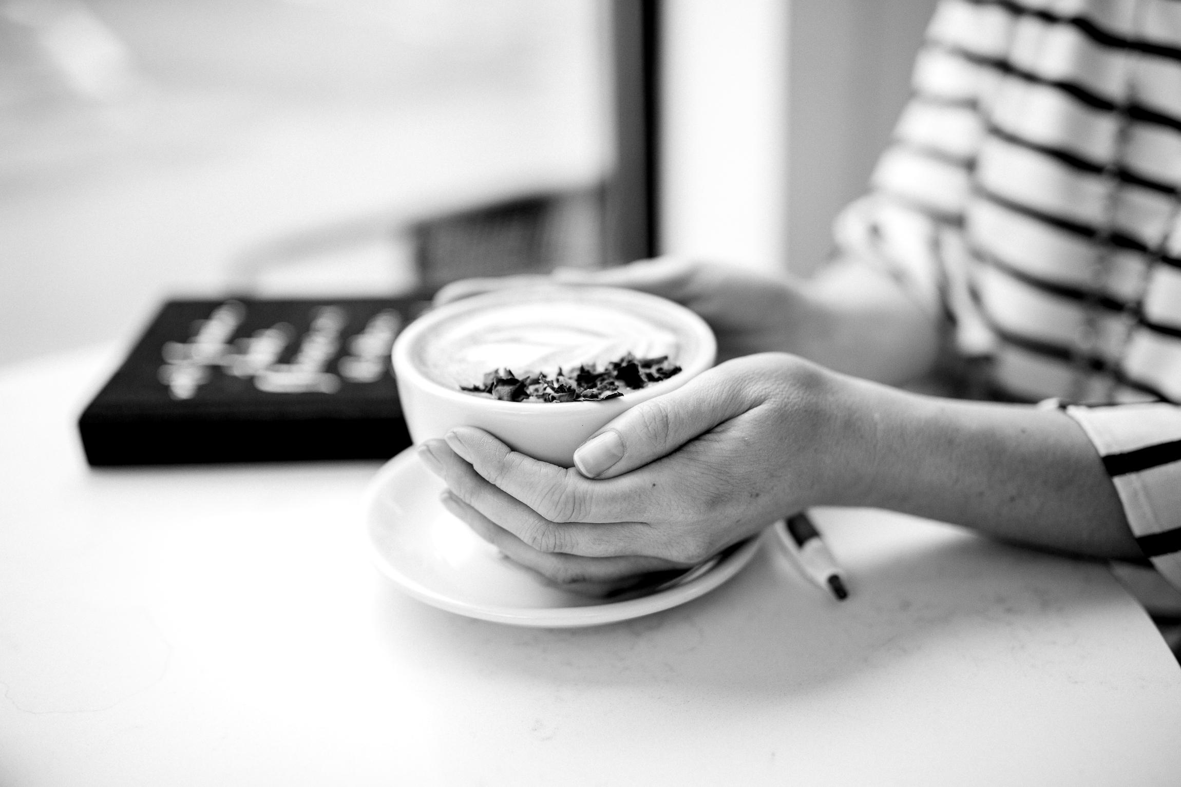 Woman drinking a latte in a coffee shop, Kansas City lifestyle photographer, Kansas City senior photographer, Kansas City small business headshots, Kansas City lifestyle blogger, candid portrait, winter portrait session, Monarch Coffee