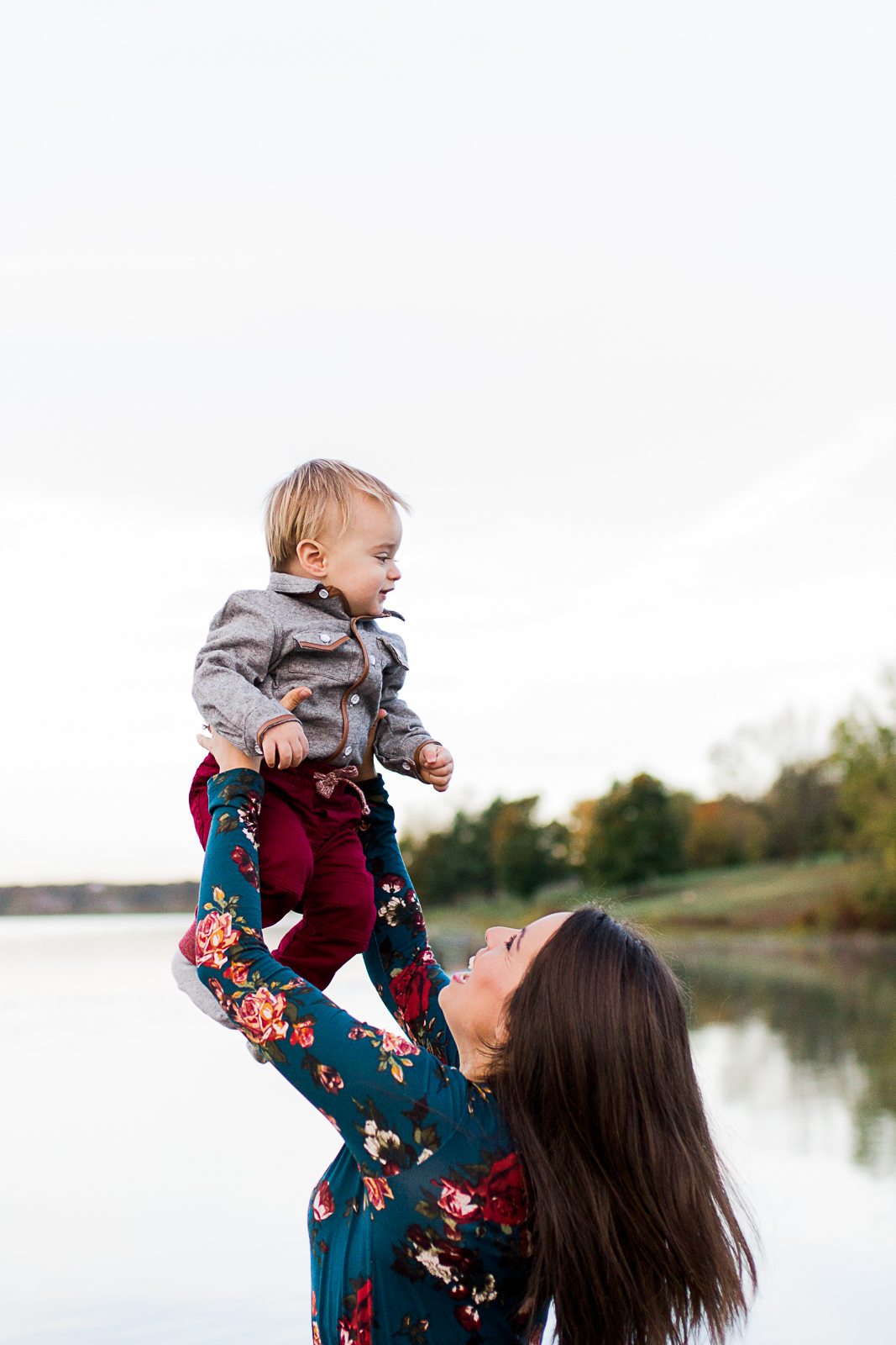 Mother lifts son up in the air, Kansas City family photographer, candid lifestyle photography, mommy and me session, Shawnee Mission Park, Rebecca Clair Photography