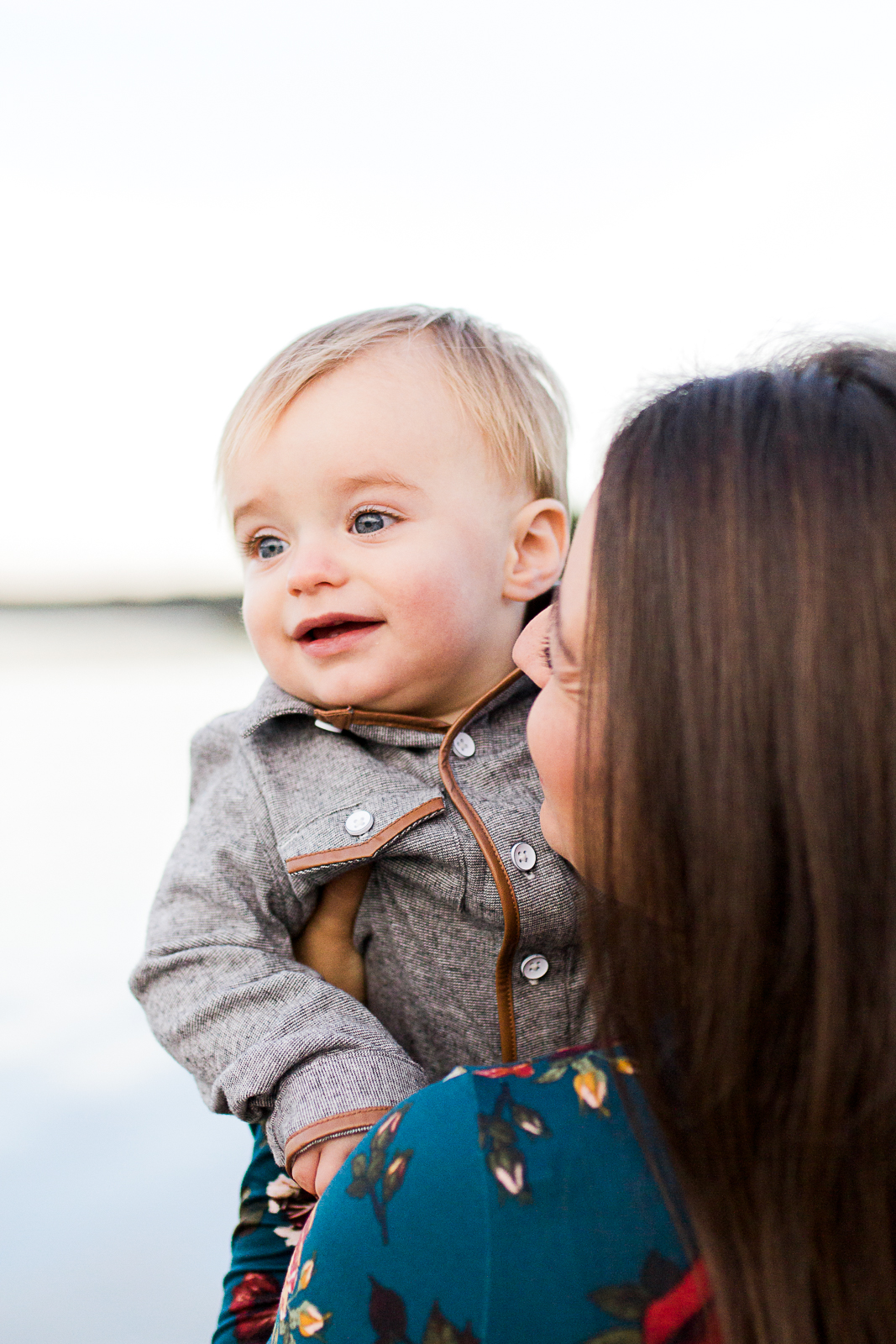 Mother holds son by the lake at sunrise, Kansas City family photographer, mommy and me session.  Shawnee Mission Park, Rebecca Clair Photography