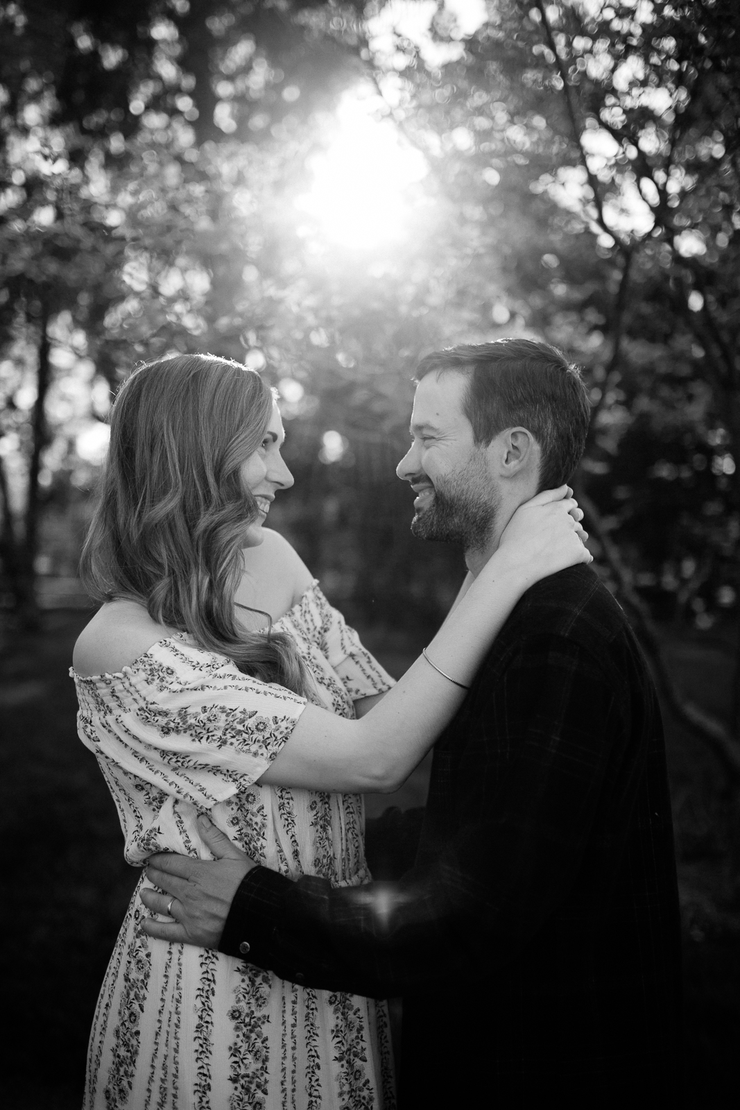 Black and white photo of a couple in the evening light, Loose Park engagement photos, Kansas City couples photography, Rebecca Clair Photography