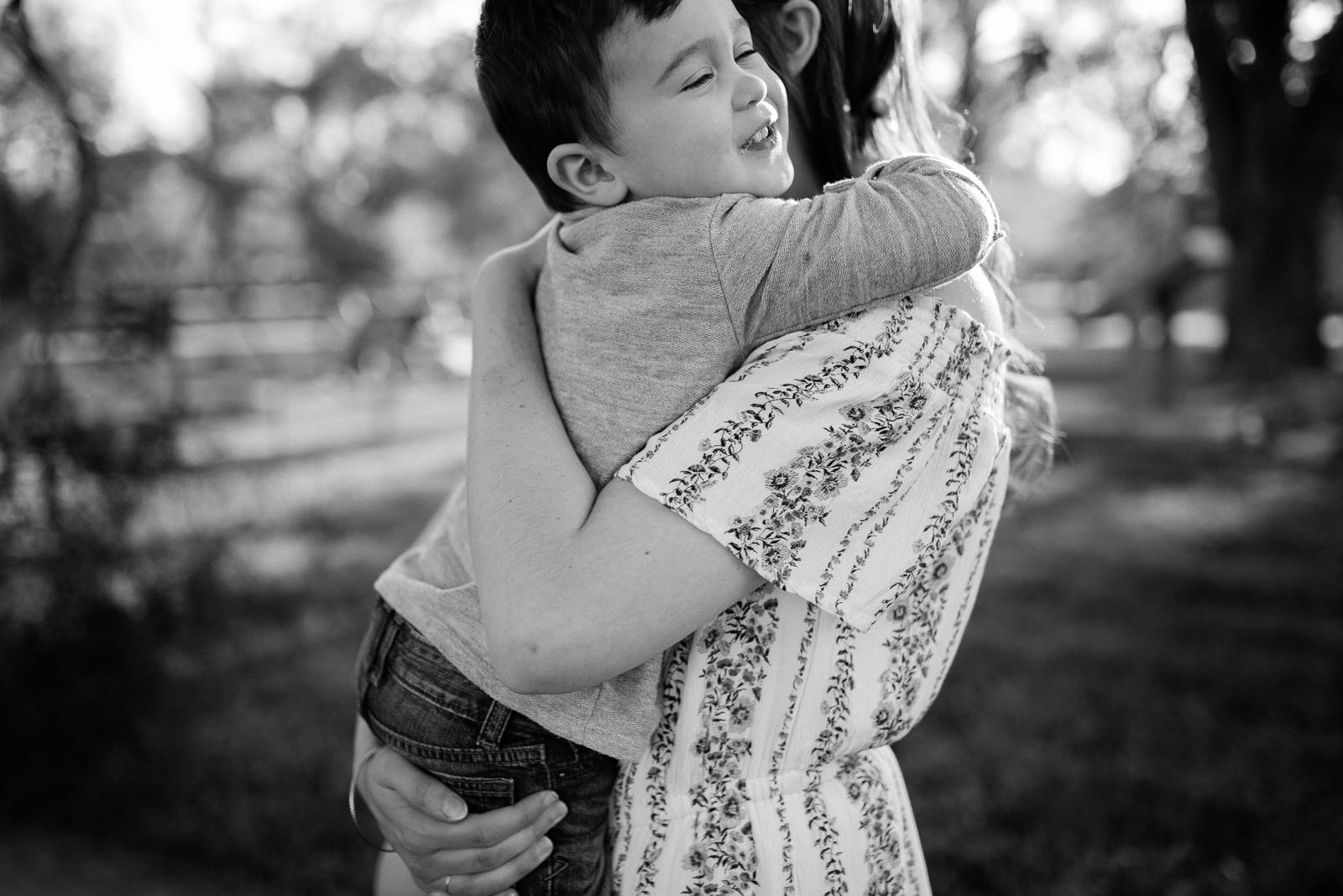 Black and white potrait of son hugging his mother, emotive family photography, Kansas City lifestyle photographer, Rebecca Clair Photography