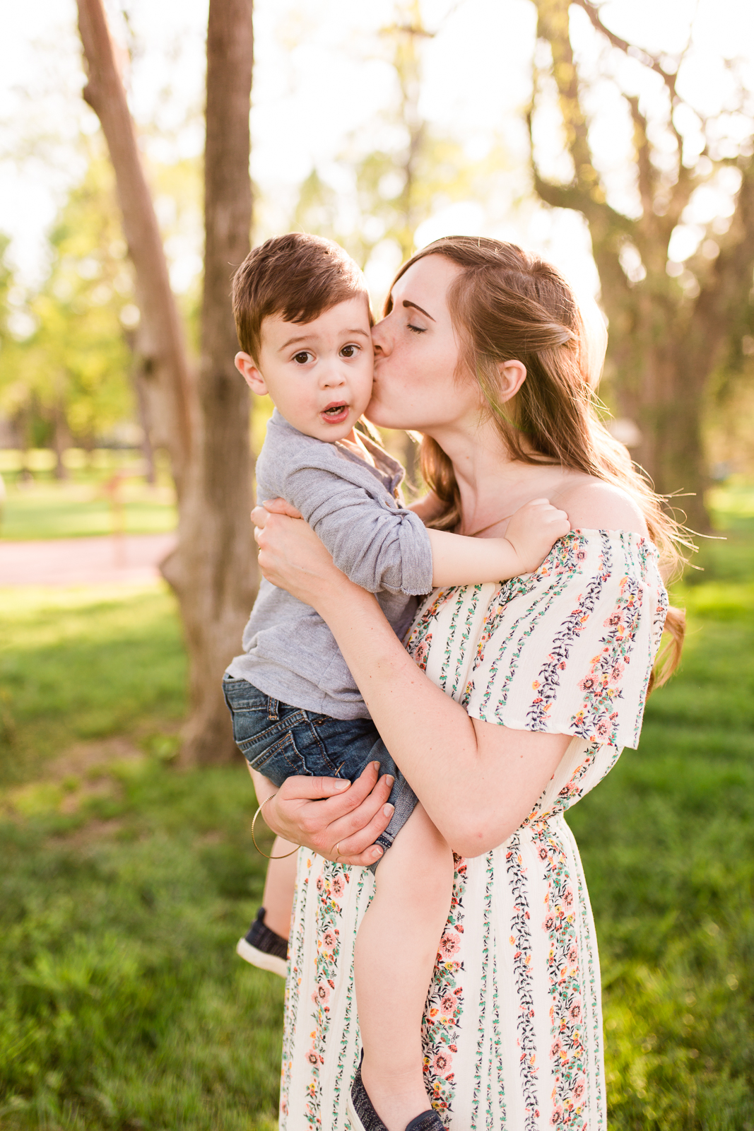 Mother kisses her son in the golden light, Kansas City family photographer, Rebecca Clair Photography