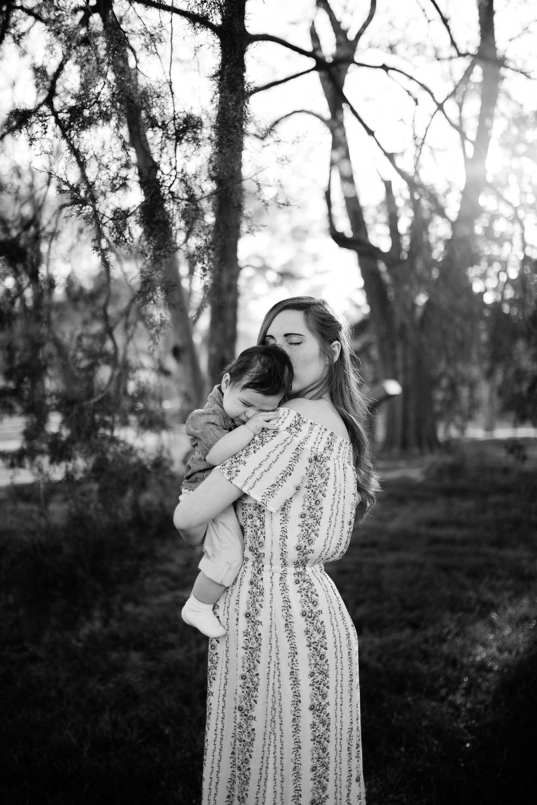 Black and white portrait of mother kissing her baby, emotive family portrait, motherhood portrait, Kansas City creative family photographer, Rebecca Clair Photography