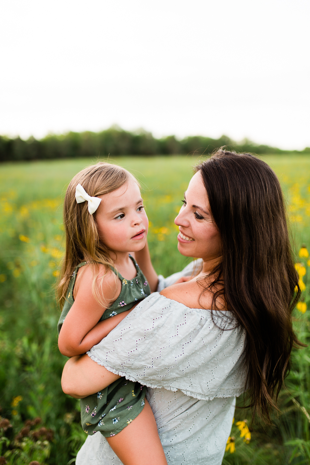 Mother holds daughter in a field, mommy and me session at Shawnee Mission Park, Kansas City lifestyle photographer