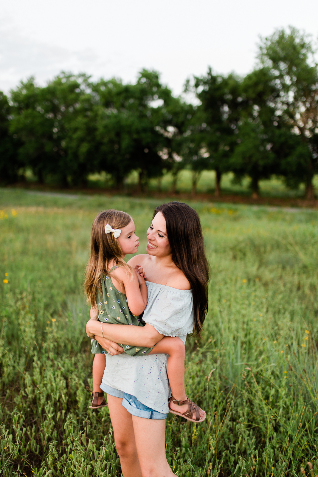 Mother and daughter smiling, mommy and me session at Shawnee Mission Park, Kansas City lifestyle photographer