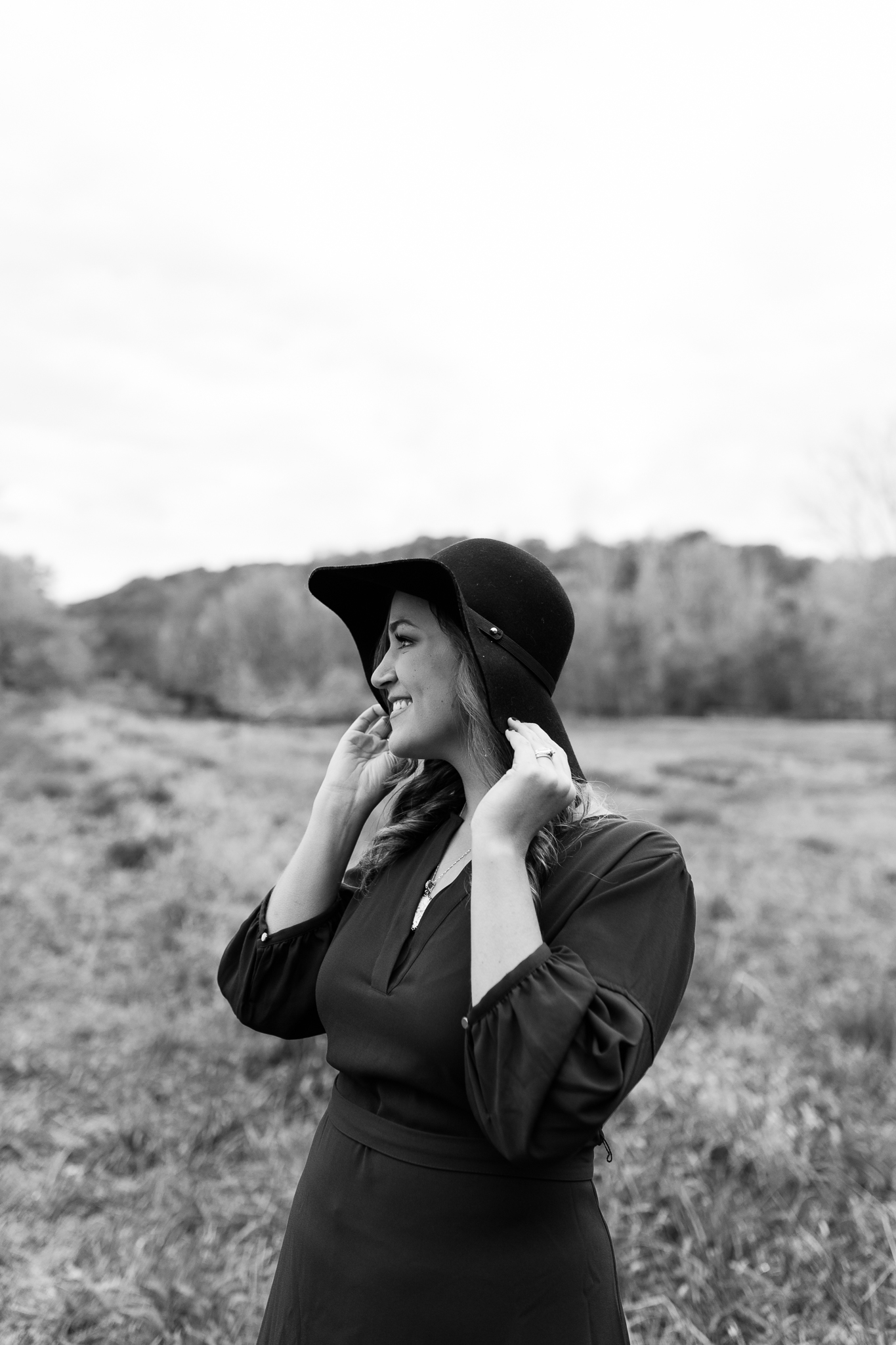Black and white portrait of a woman in a hat, black and white non-traditional headshot, Kansas City portrait photographer, Rebecca Clair Photography