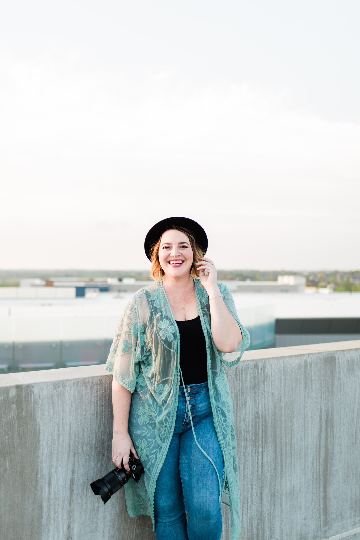 Photographer laughs on the rooftop, Kansas City photographer's headshots, Rebecca Clair Photography