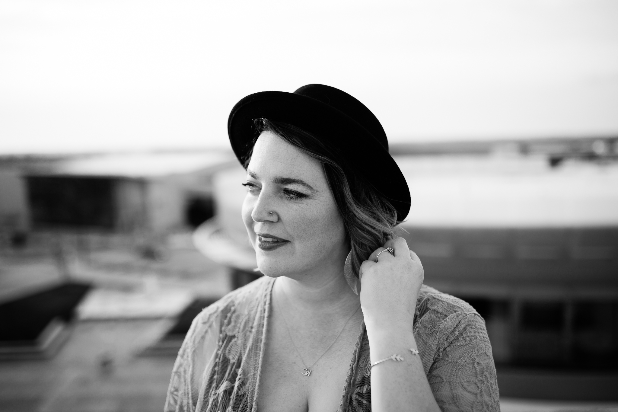 Black and white portrait of woman on a rooftop, Kansas City black and white headshot, Rebecca Clair Photography