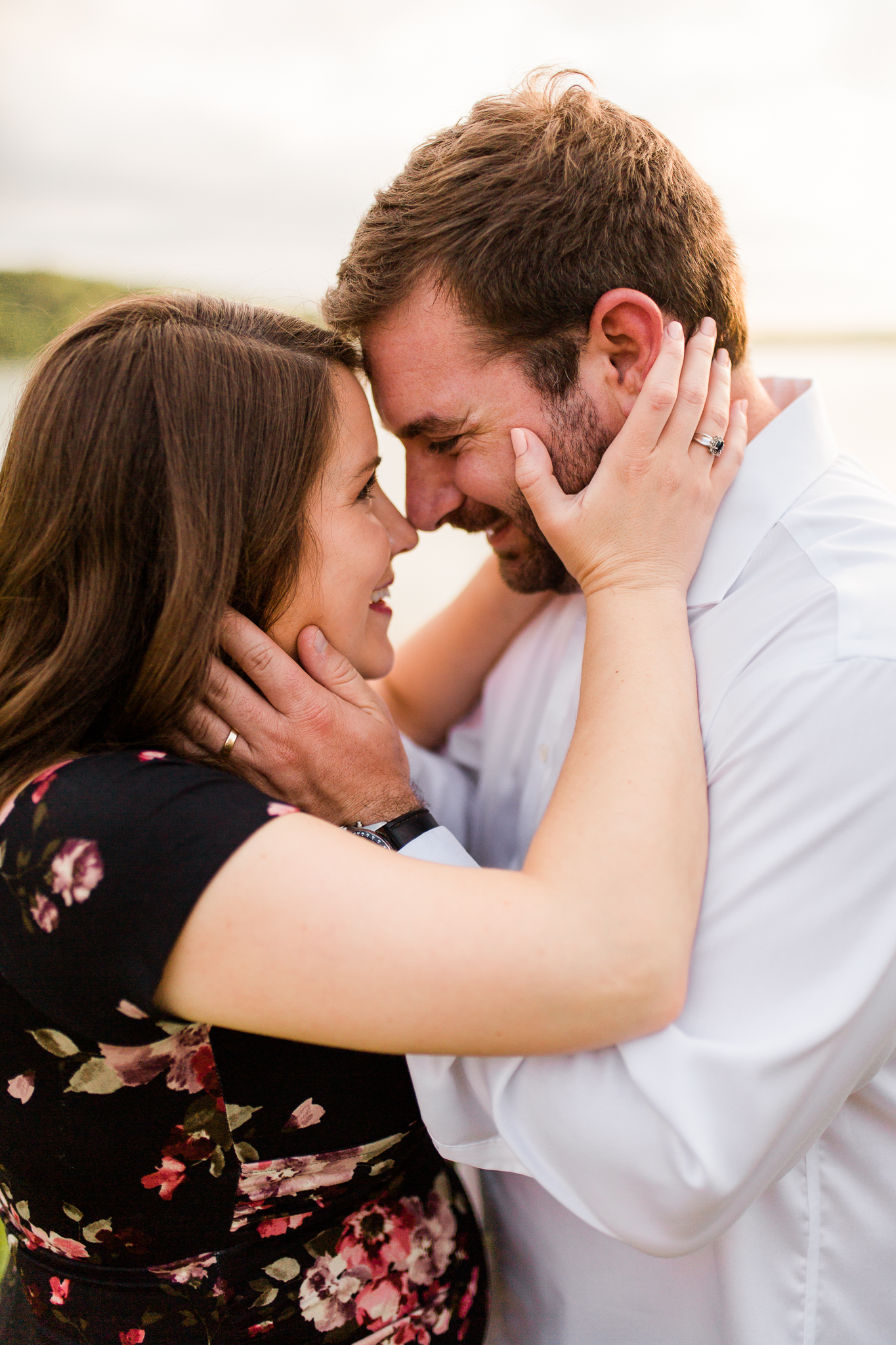 Close up of a pregant couple touching noses at sunset, Kansas City candid lifestyle maternity photographer, Shawnee Mission Park, Rebecca Clair Photography