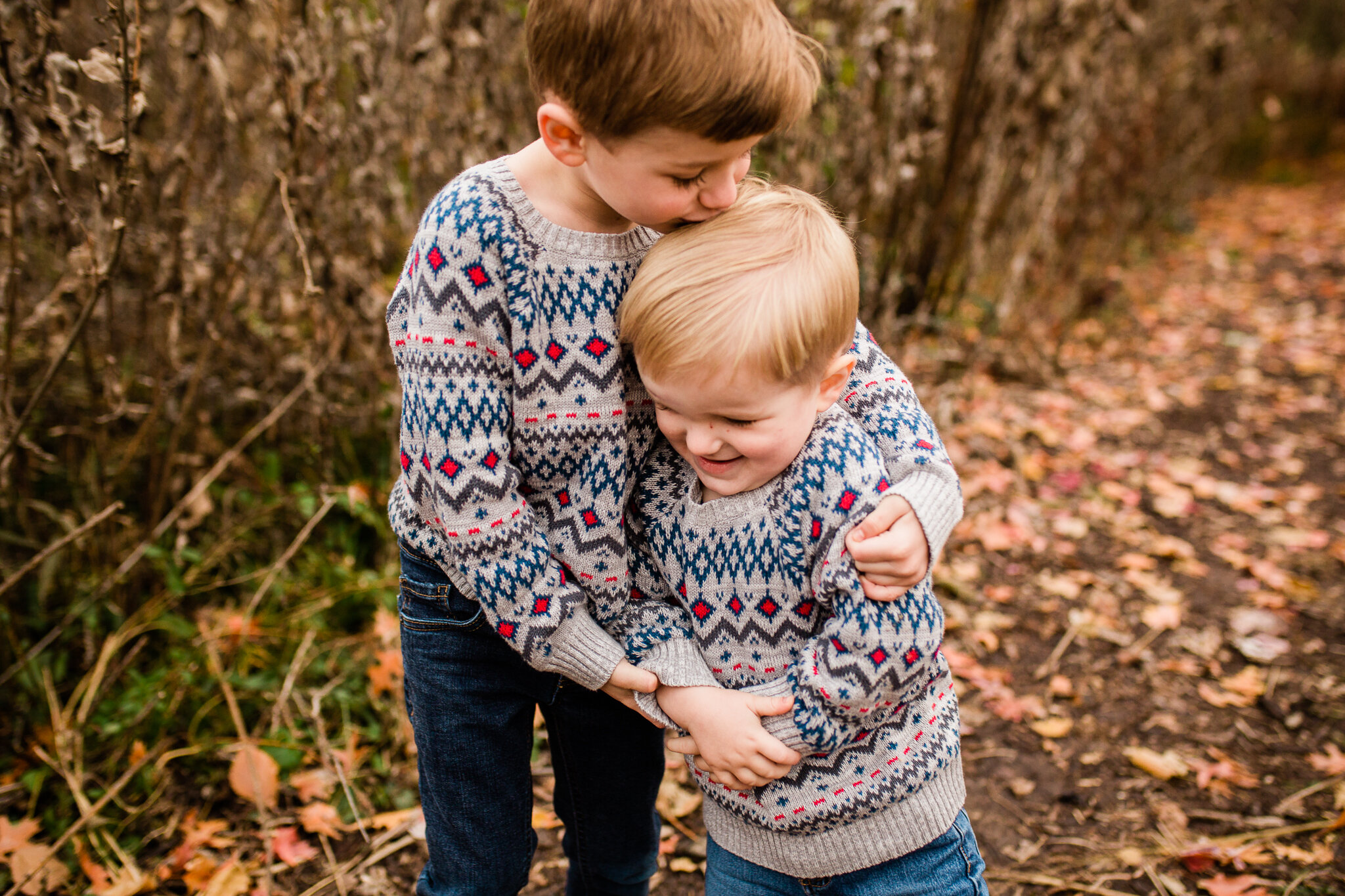 Two brothers in matching sweaters hug, Kansas City family photographer, Rebecca Clair Photography