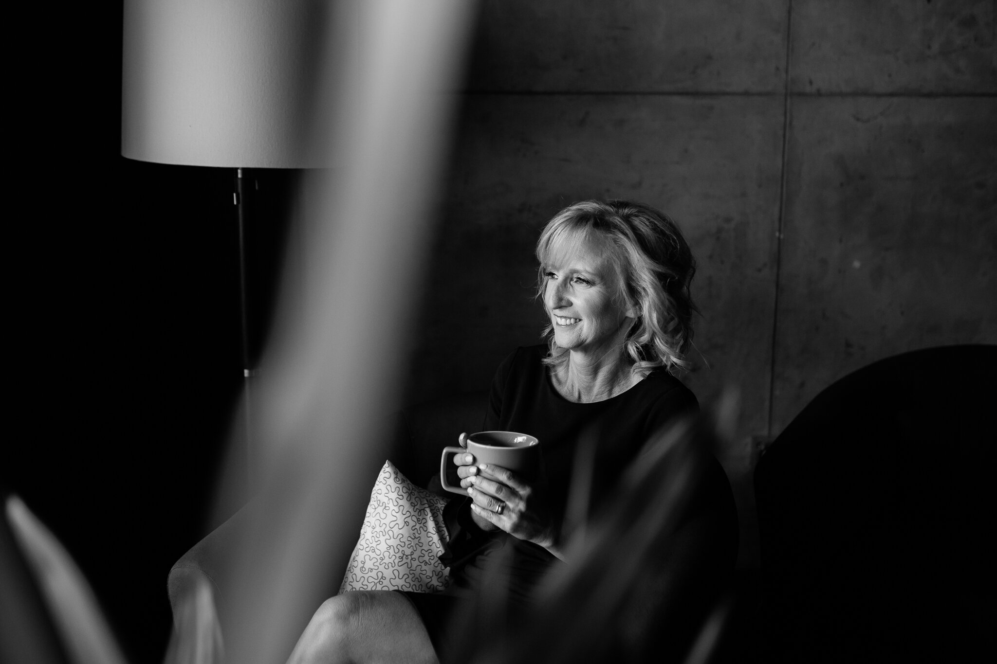 Woman sits with a cup of coffee in her office, Kansas City informal headshots, Rebecca Clair Photography