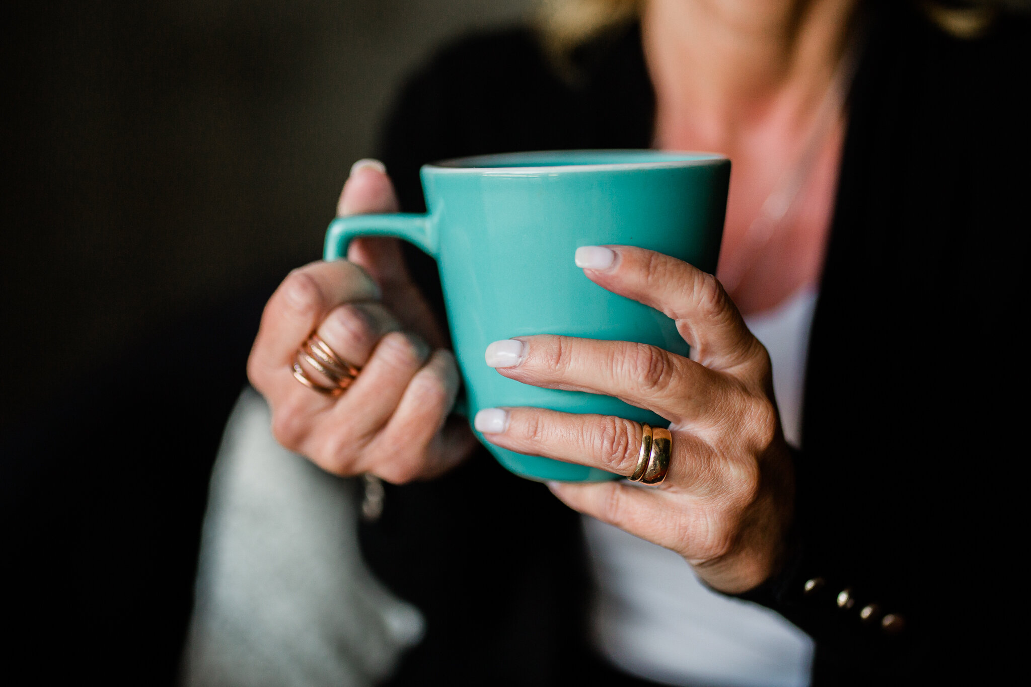 Close up of hands holding coffee, Kansas City small business photography, Rebecca Clair Photography