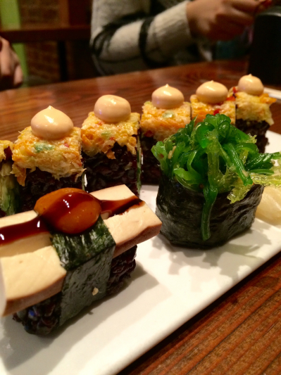 Spicy mango roll with baked tofu and seaweed hand pieces