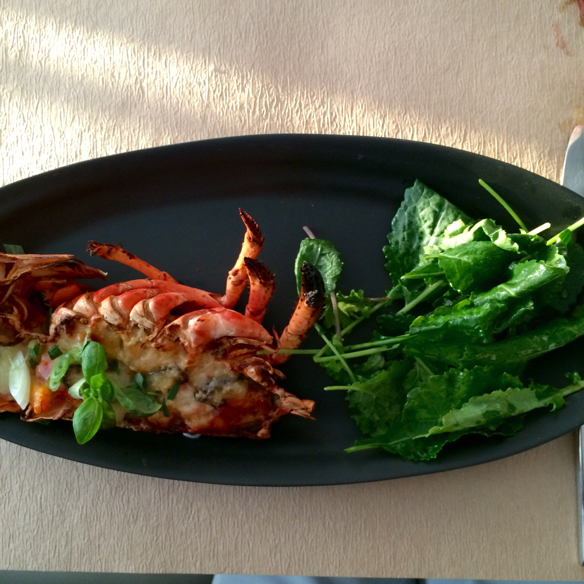 Lobster thermidor with gruyere, shiitake mushrooms, and tarragon served with kale salad