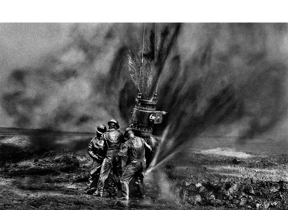 Workers struggle to remove bolts, oil wells, Kuwait, 1991   20 x 24 inches  Gelatin silver print