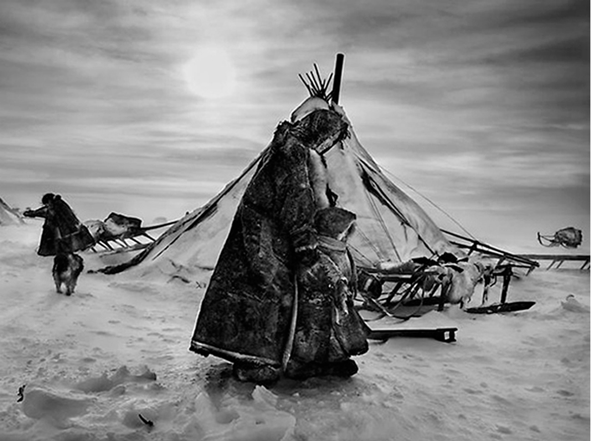 Nenets, an indigenous nomadic people, whose main subsistence come from reindeer herding, South YamalRegion, Siberia, Russia (Mother and child bundled), 2011   20 x 24 inches  Gelatin silver print