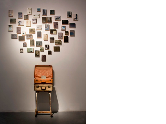 A Sense of Home, 2011  Antique stand and suitcases, 50 waxed photographs mounted on wooden boxes
