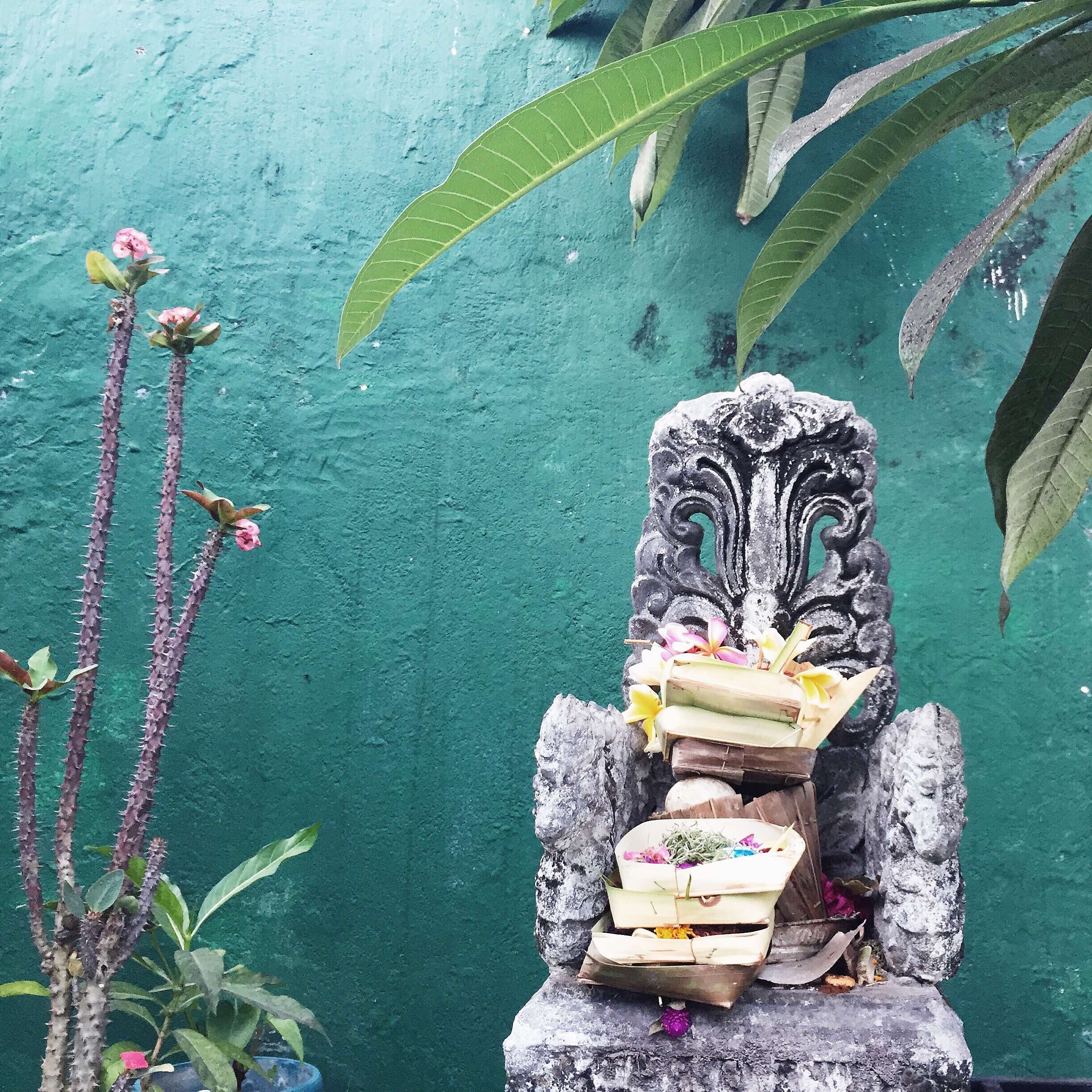 A day's worth of offerings, stacked high on a stone altar. (c) 2015 Gail Jessen, A Series of Adventures