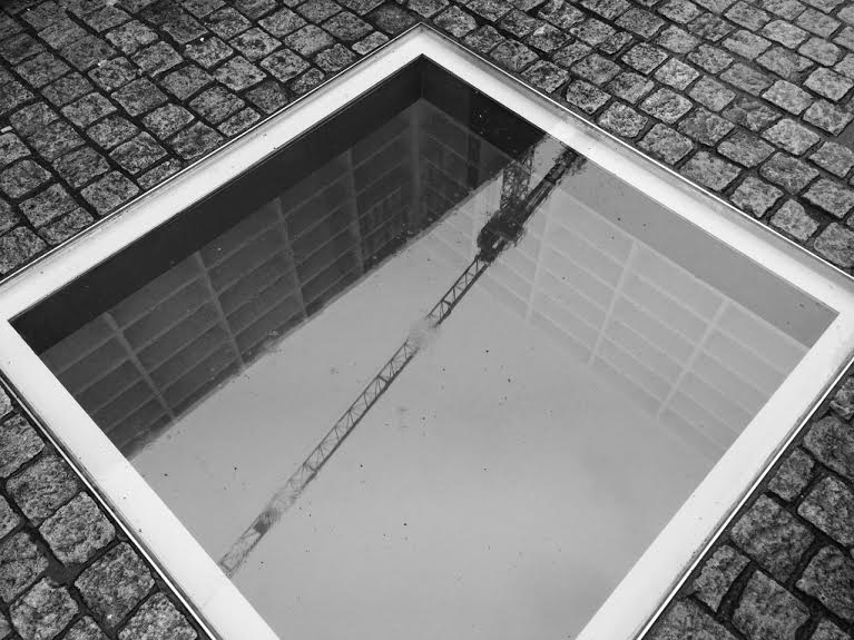 Nazi Book Burning Memorial in Berlin (reflecting nearby construction crane)   Photo: Christine Schoefer
