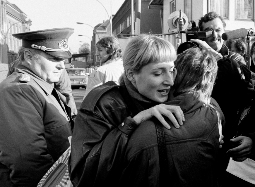 An East German woman embraces a West German woman at the Invalidenstrasse border checkpoint after the opening of the Berlin Wall was announced, Nov. 10th, 1989 .  Source: REUTERS