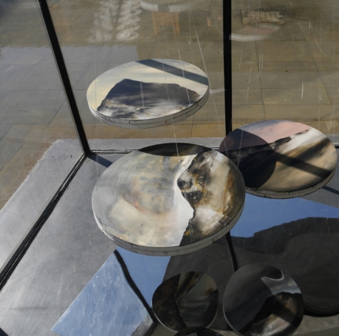 I See You in the Light of the Water  , 2014, acrylic on canvas, mirrored steel, dimensions variable   I See You in the Light of the Water    An installation at the Inside-Out Art Museum, Beijing, China. A seriesof paintings are suspended over a mirrored 'pond.' The dual paintings -  one above and another below, back-to-bac- present an alternate landscape in the mirrored reflection, while taking its Oriental sentiment from water lilies on a pond.