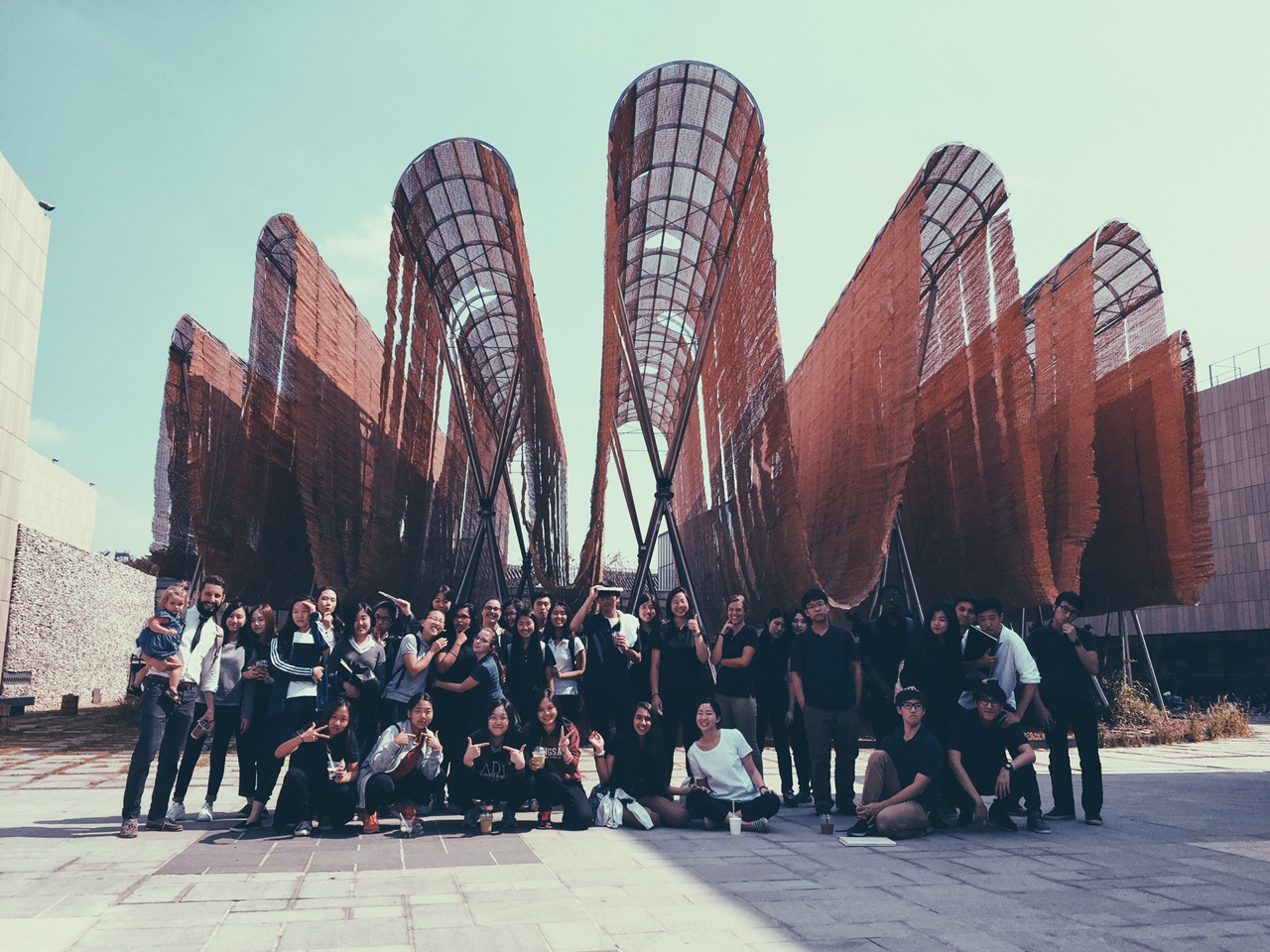 Students in front of the Young Architects project at the Museum of Modern + Contemporary Art.
