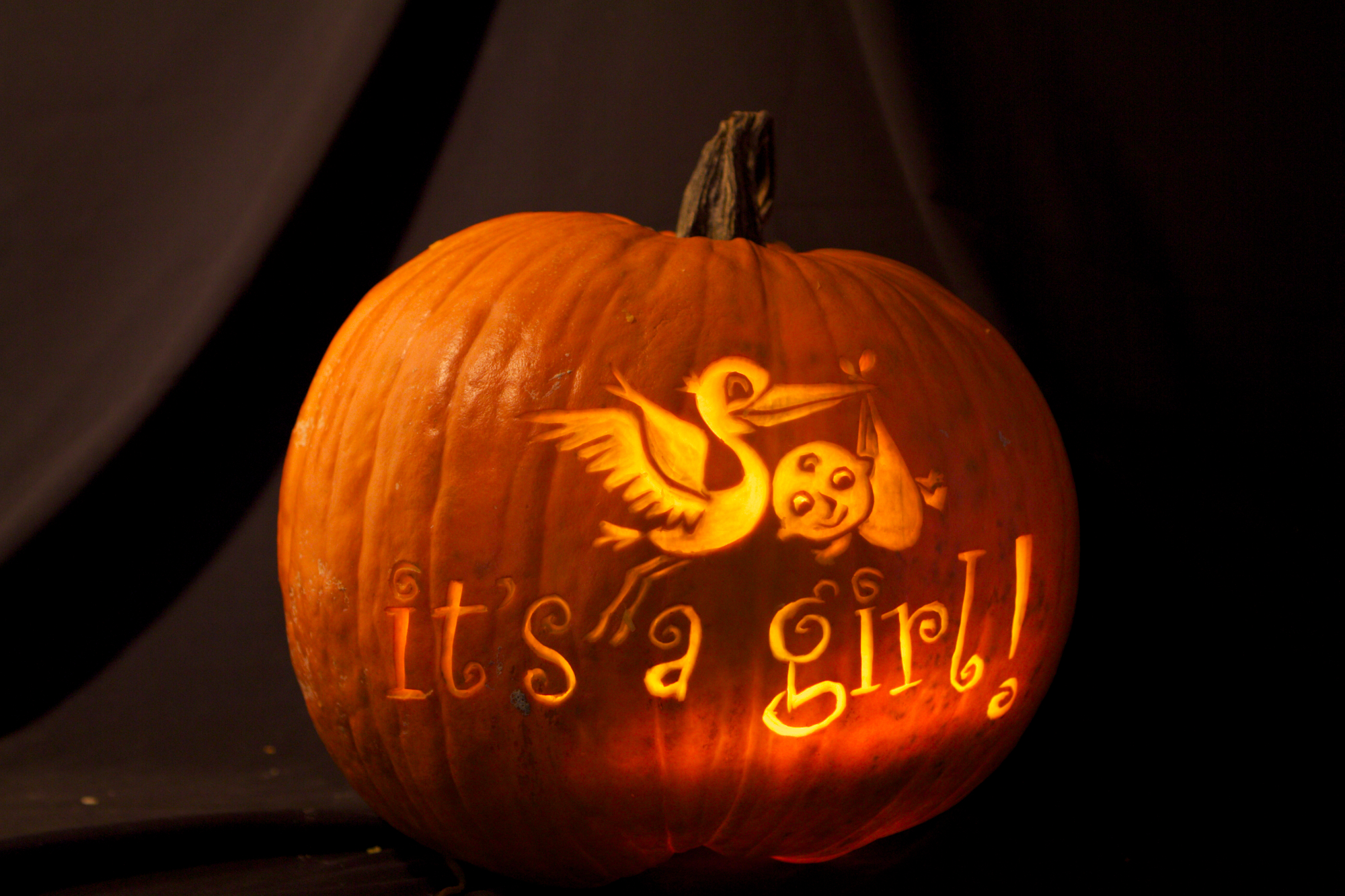 Large pumpkin with text and graphics.