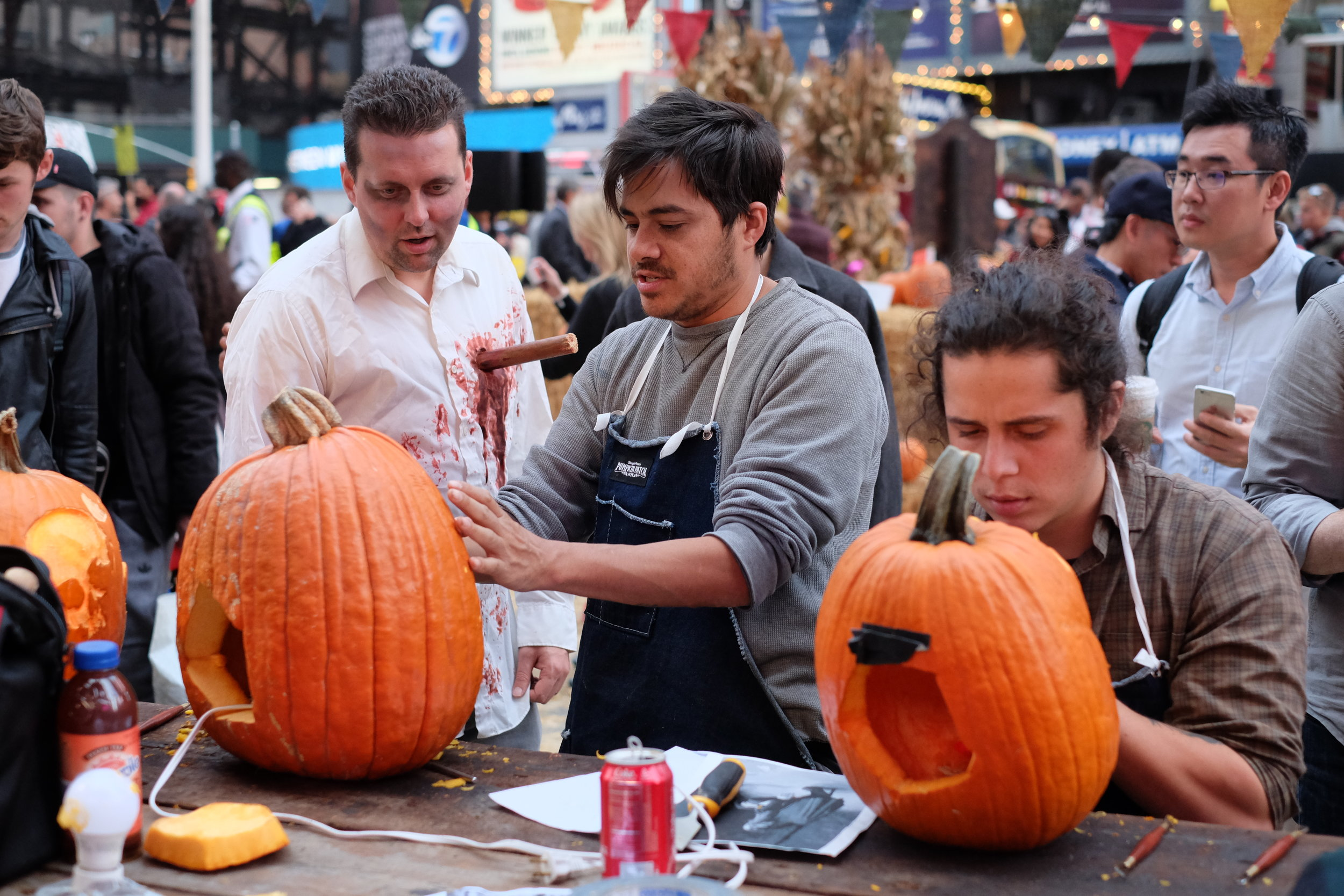 Chris and Jose carving pumpkins during a massive Times Square activation for Google Photos.