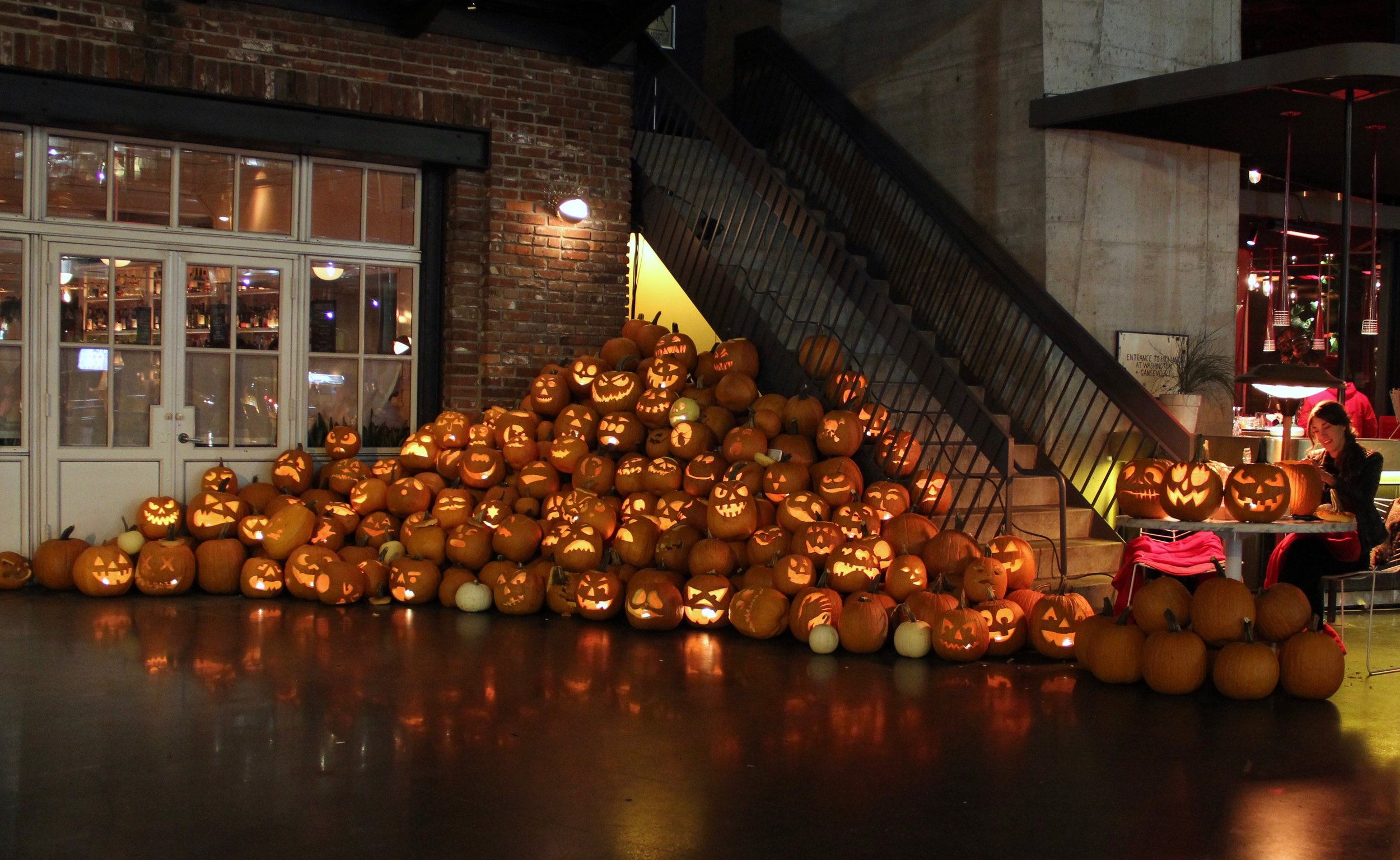 A display featuring over 100 Jack O Lanterns, carved for the Standard Hotel, NYC.  CLASSES, WORKSHOPS, & LIVE EVENTS  Our carvers can work on site (or in our workshop) to create an incredible display of classic Jack O' Lanterns for your event. We also offer Jack O' Lantern classes, workshops, and carving parties, so you and your group can get hands on pumpkin carving tips from a pro. Contact us for info!