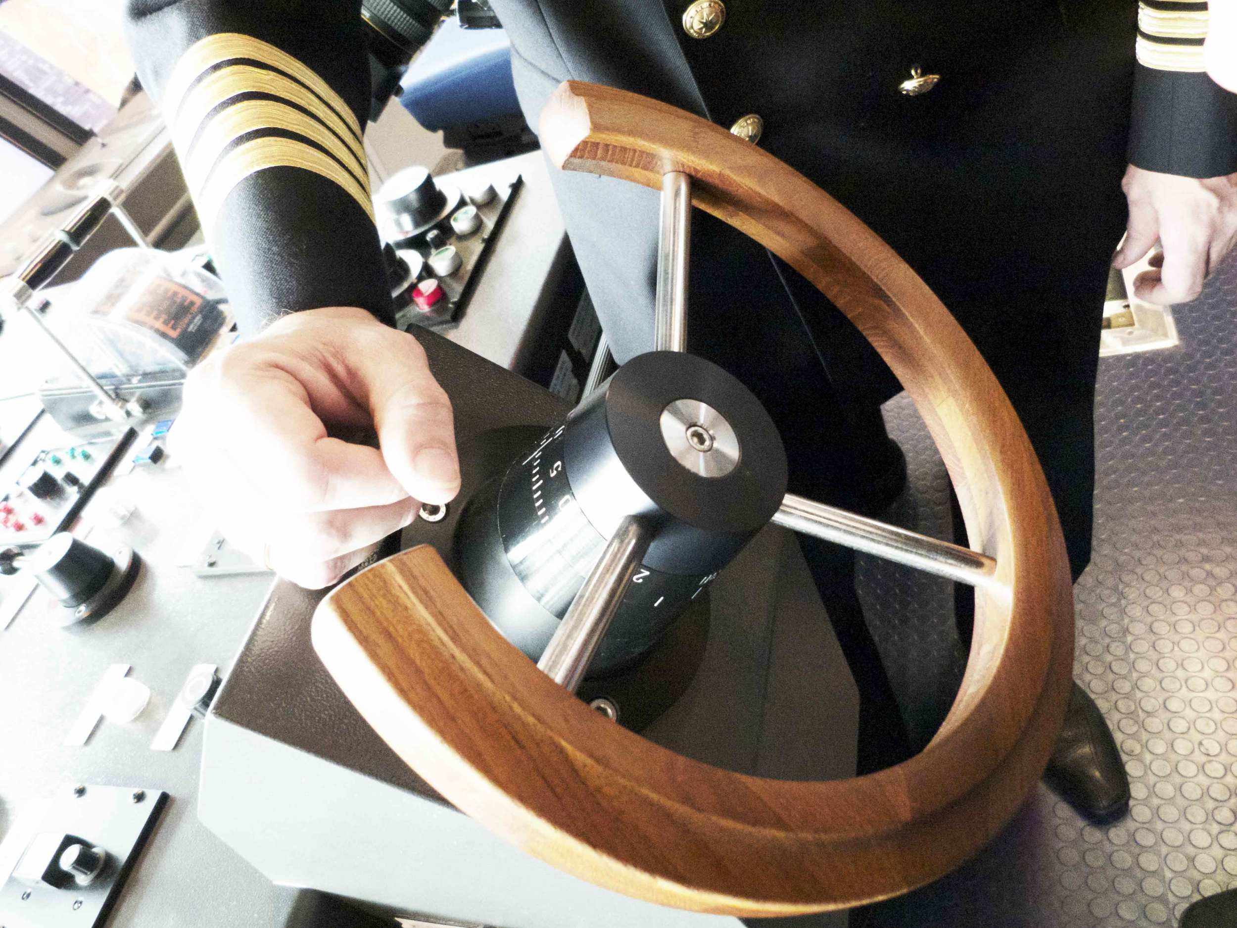 Modern super ships still have wooden steering wheels. This picture is from a MAERSKtriple E class container ship.