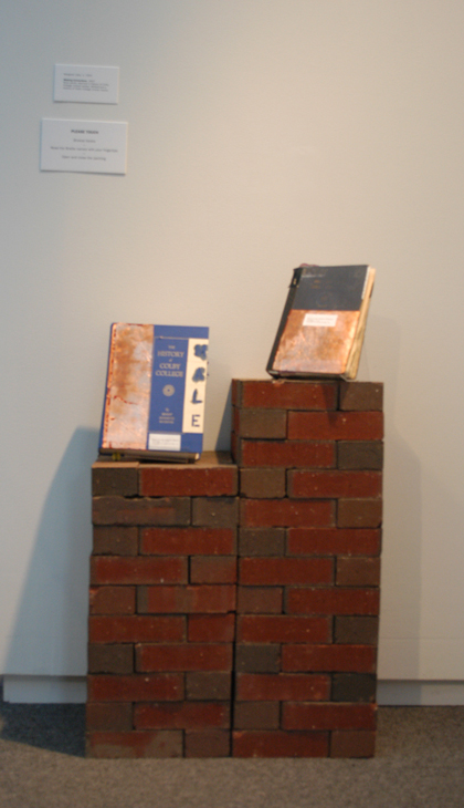 Altered books (Histories of Colby College) on brick plinth. Installation, 2007.