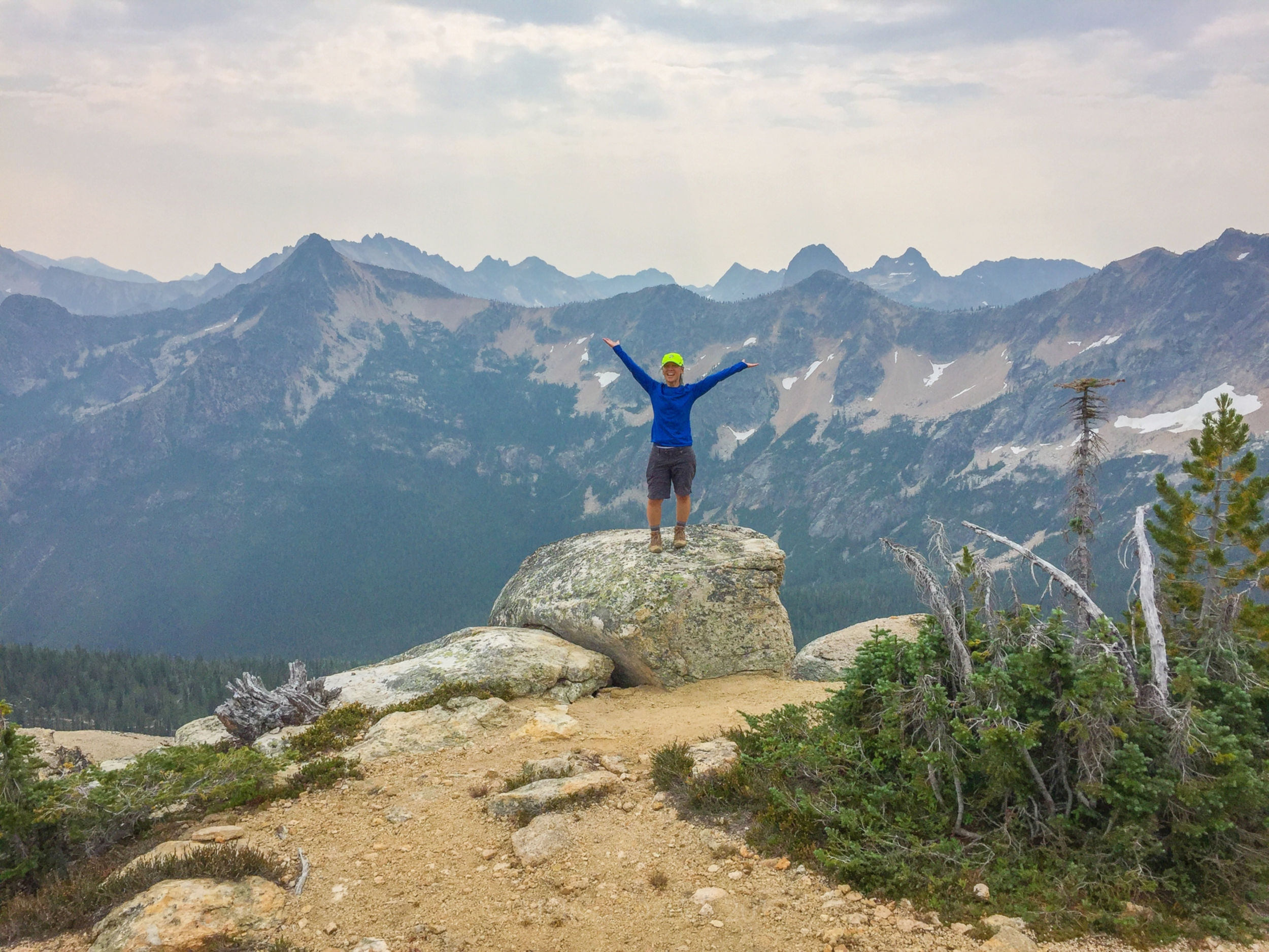 Celebrating at Cutthroat Pass, with a small, bell-shaped Liberty Bell Mountain in the background