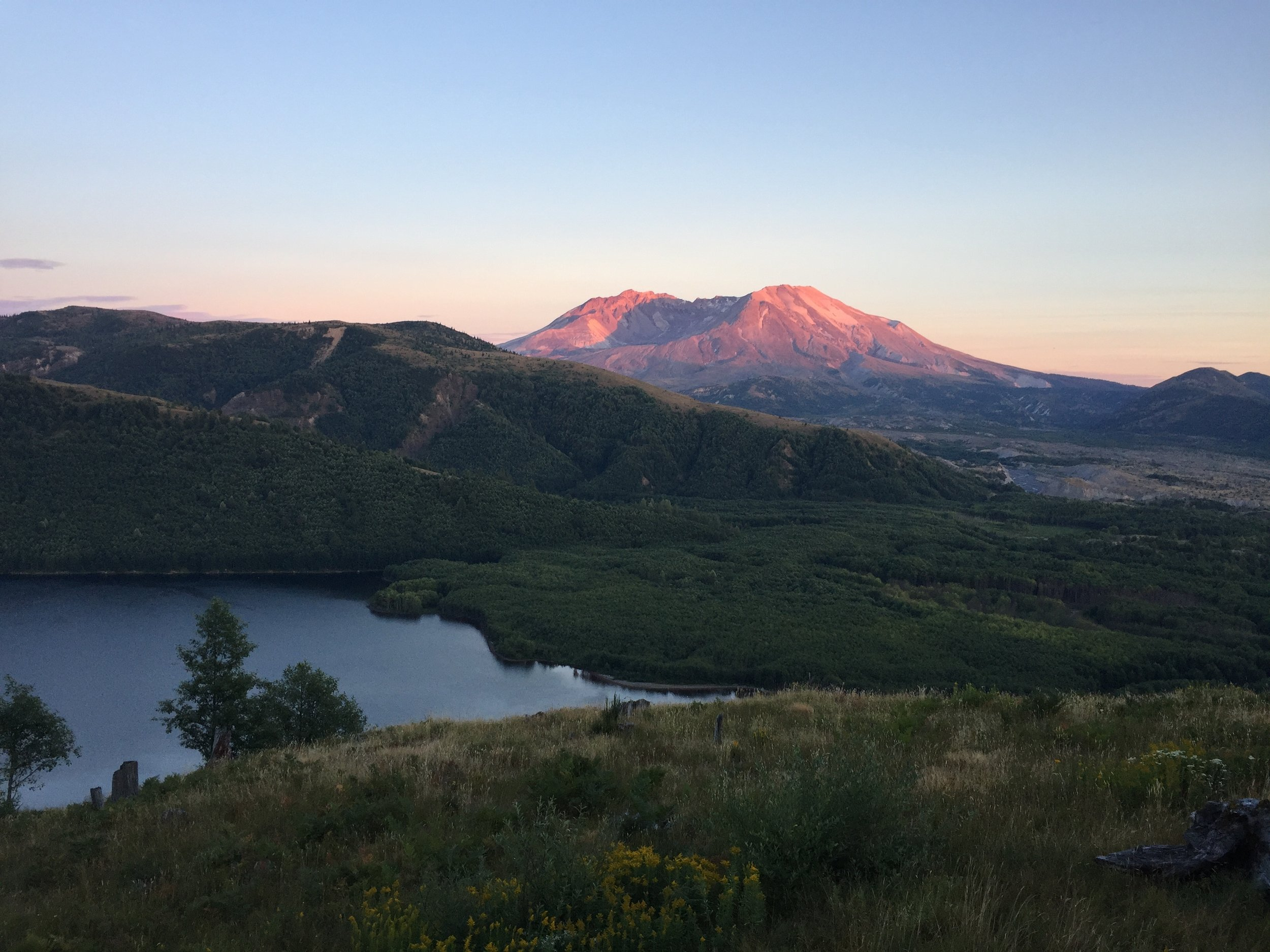 Alpenglow on Mount St. Helens. Coldwater Lake below. View from the deck of the Mount St. Helens Science and Learning Center.
