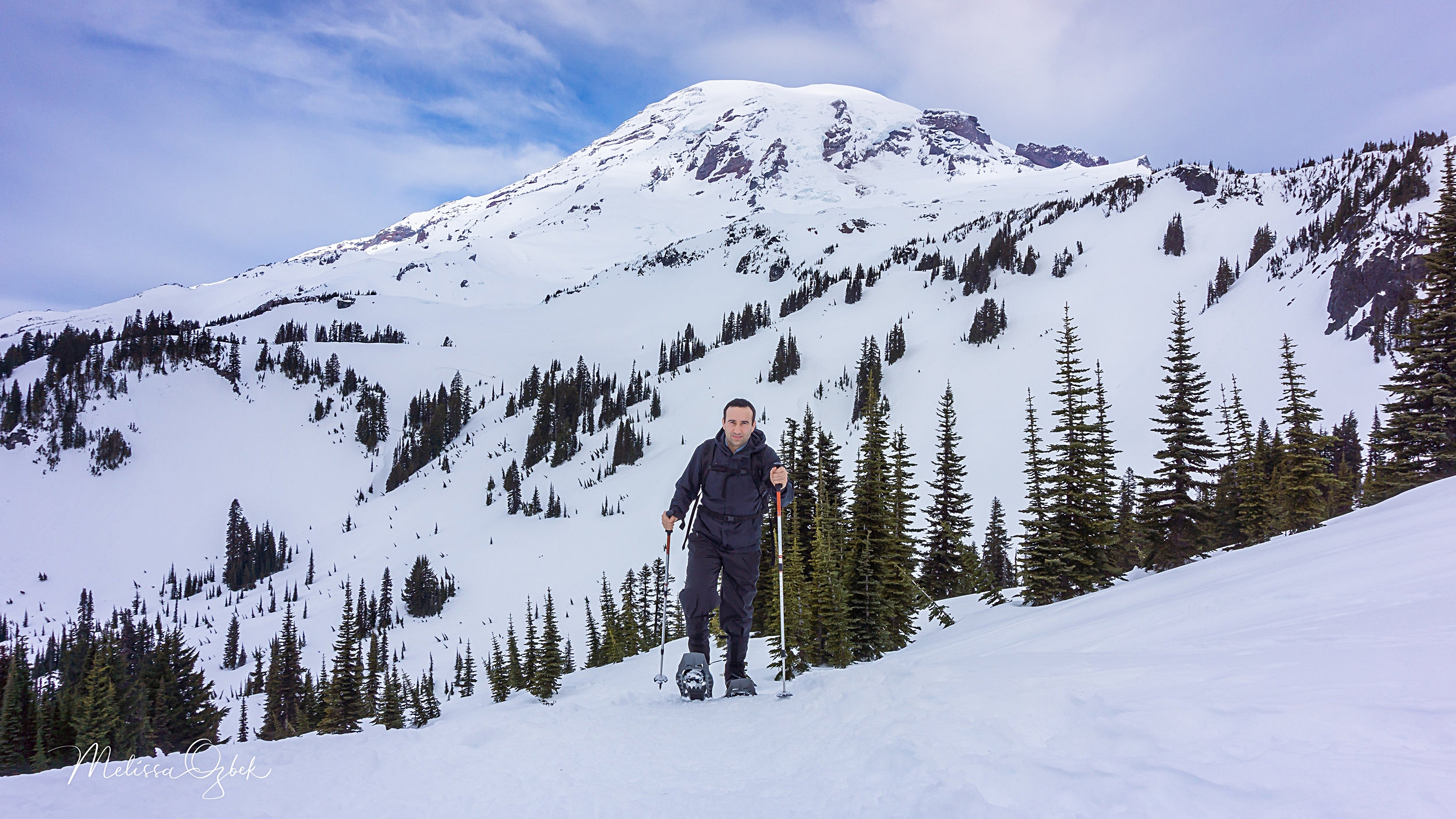 Onur snowshoes the 4th Crossing to Mazama Ridge. Mount Rainier in the background.